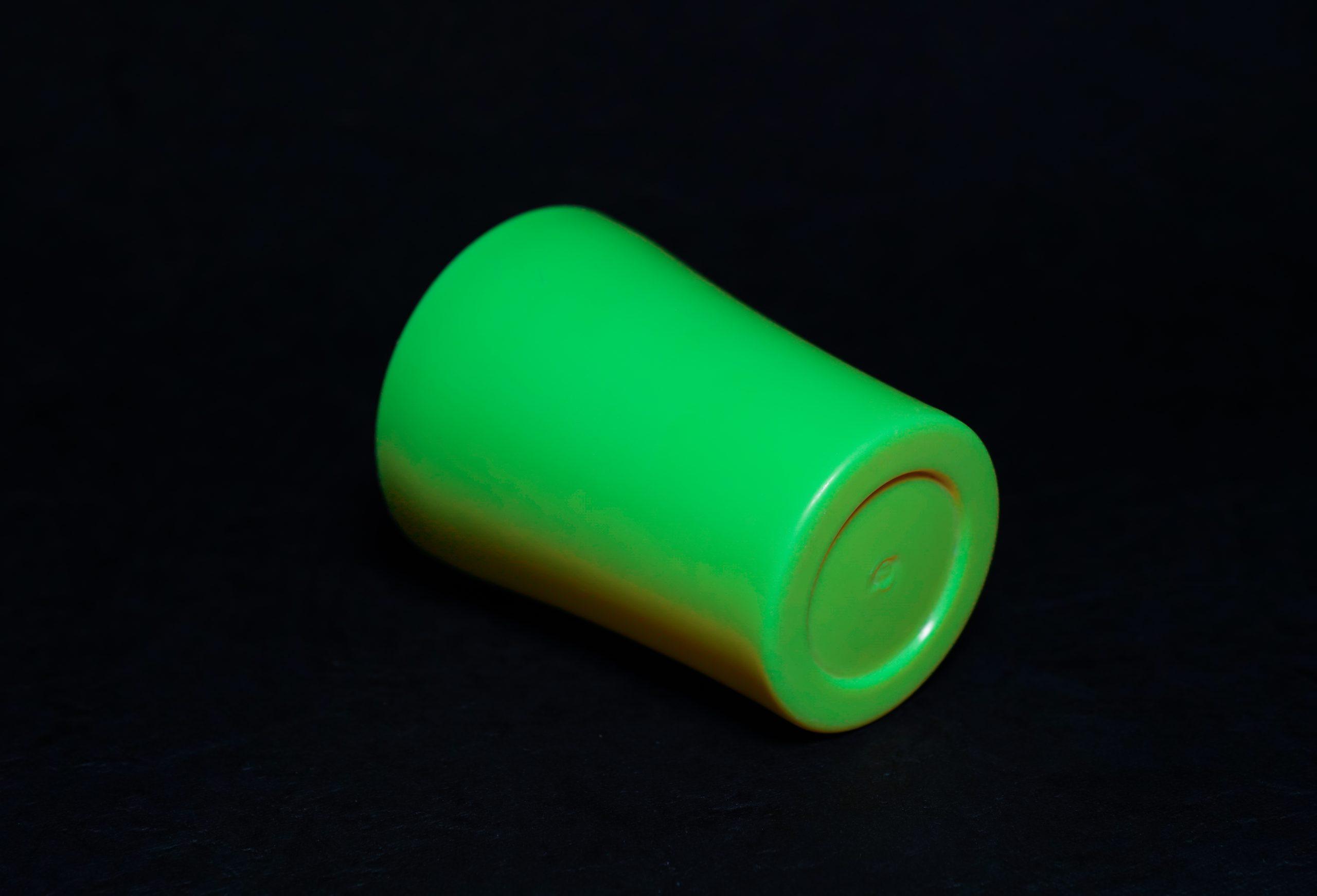 A green plastic tumbler