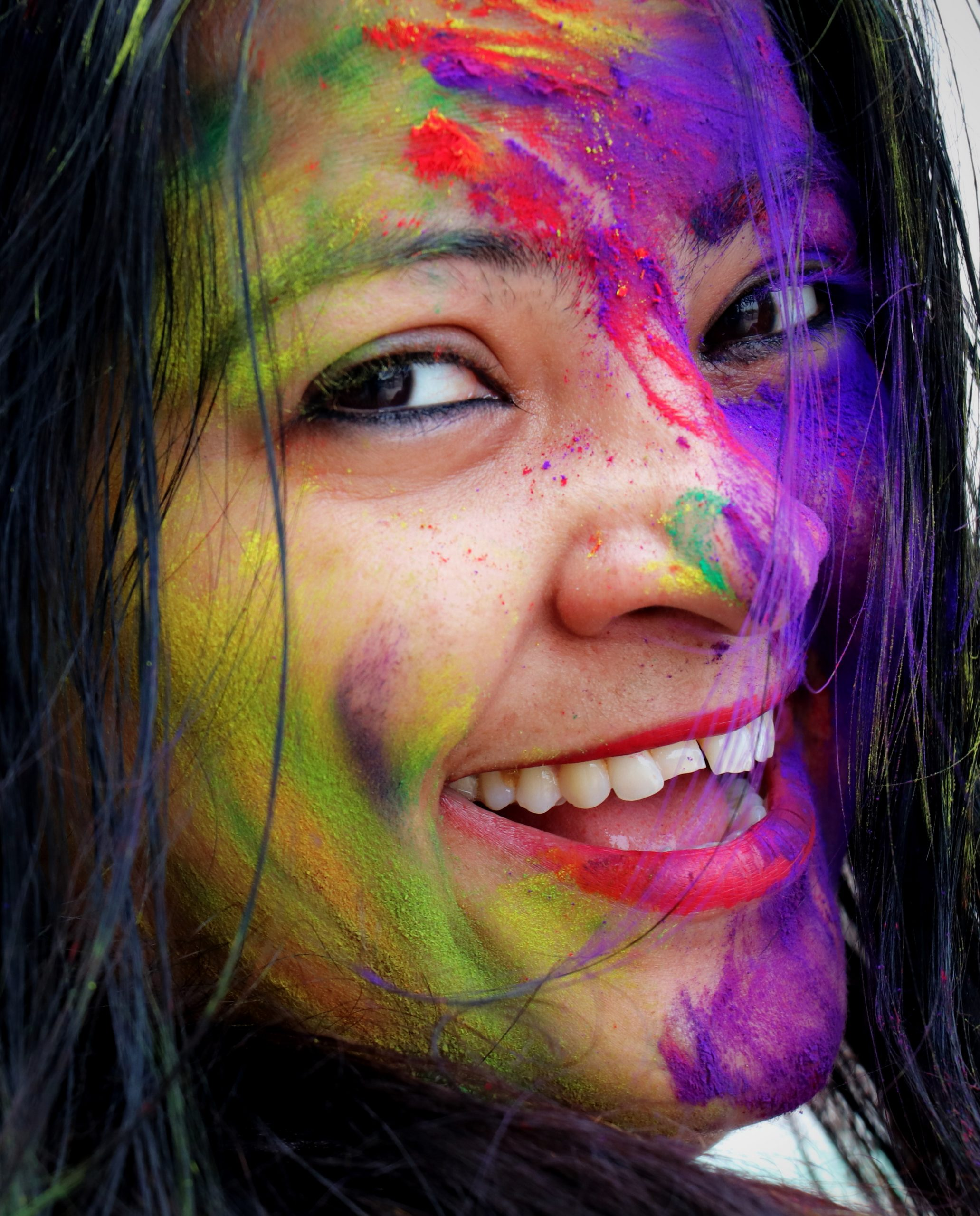A happy girl playing Holi