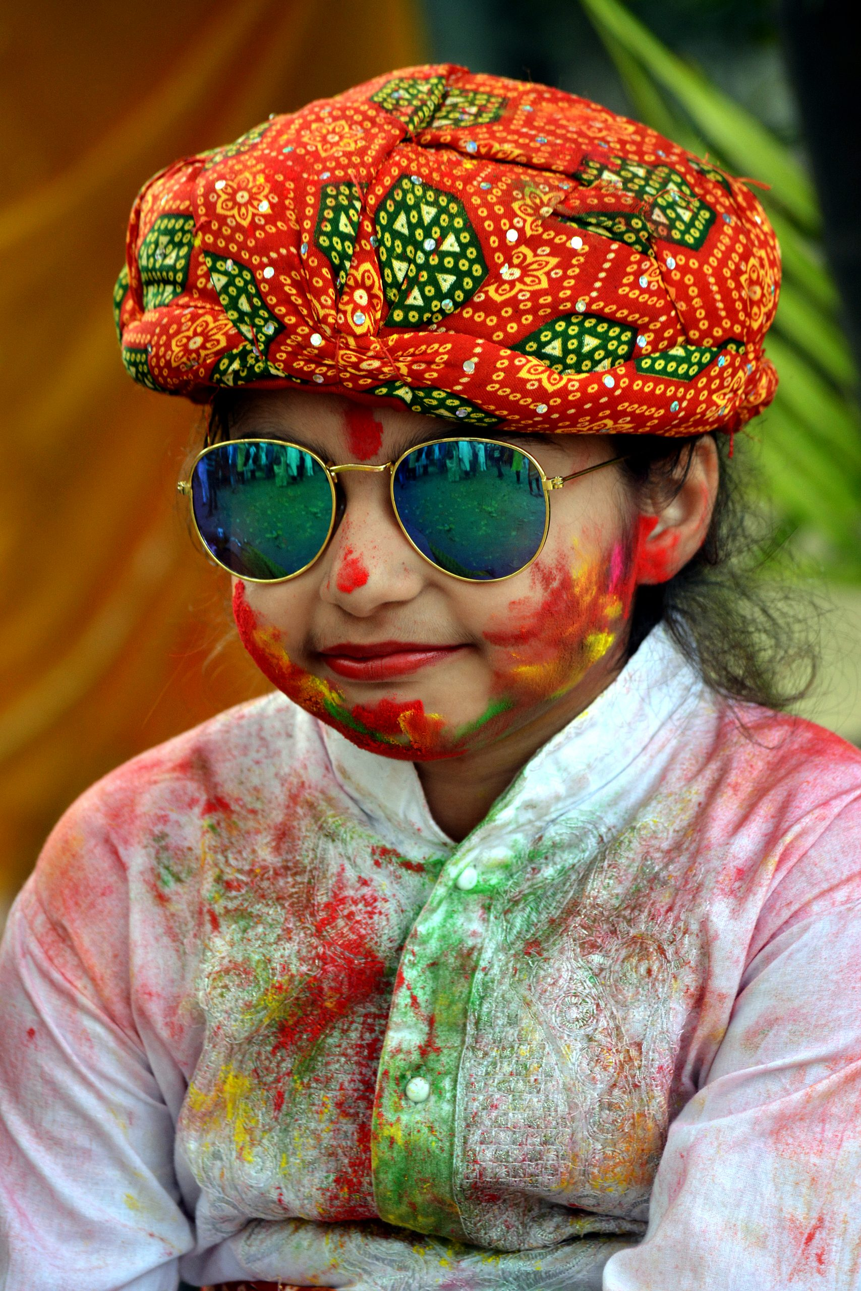 A kid during Holi festival