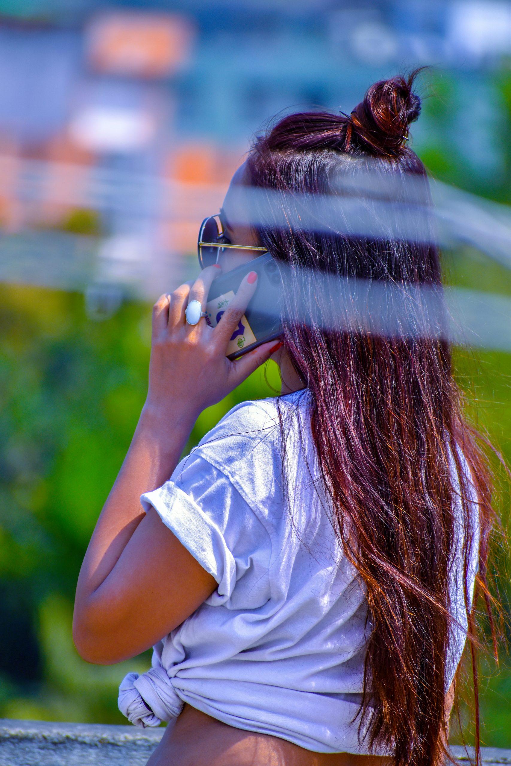 A long hair girl attending a phone call