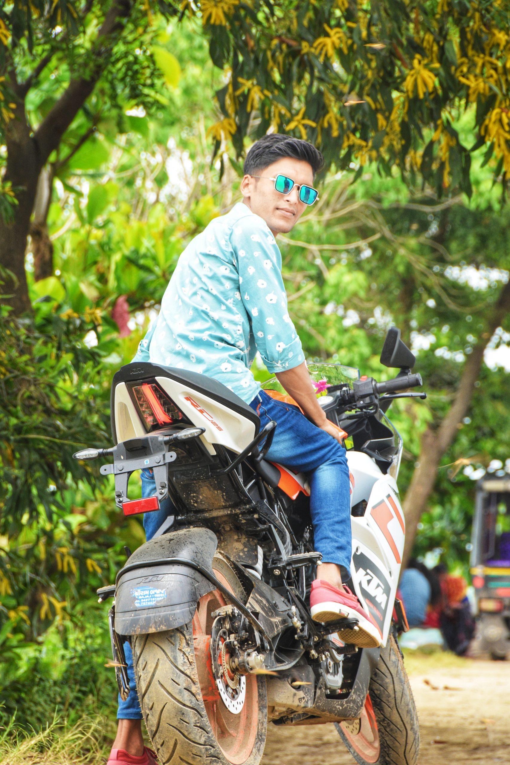 A male model on a bike