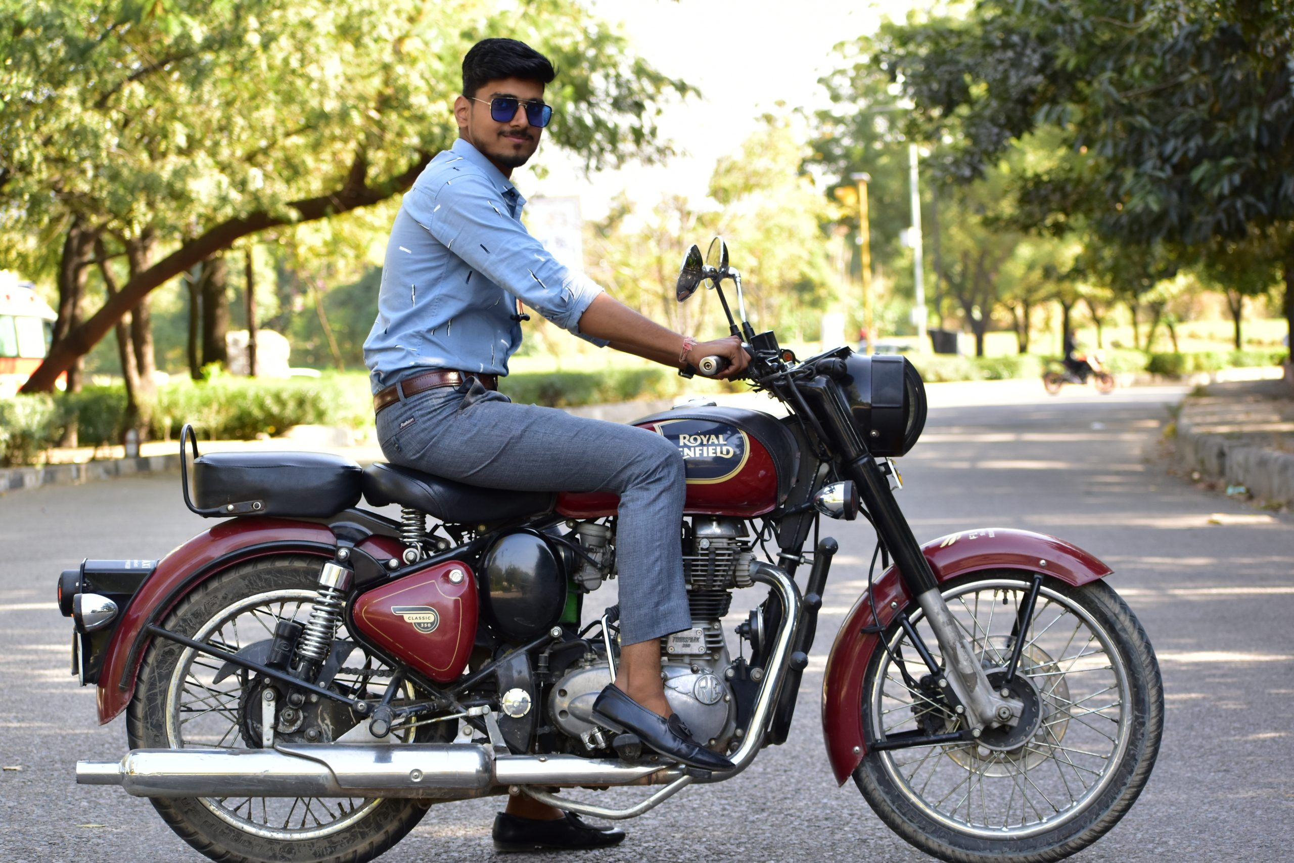 A man on a Royal Enfield bike