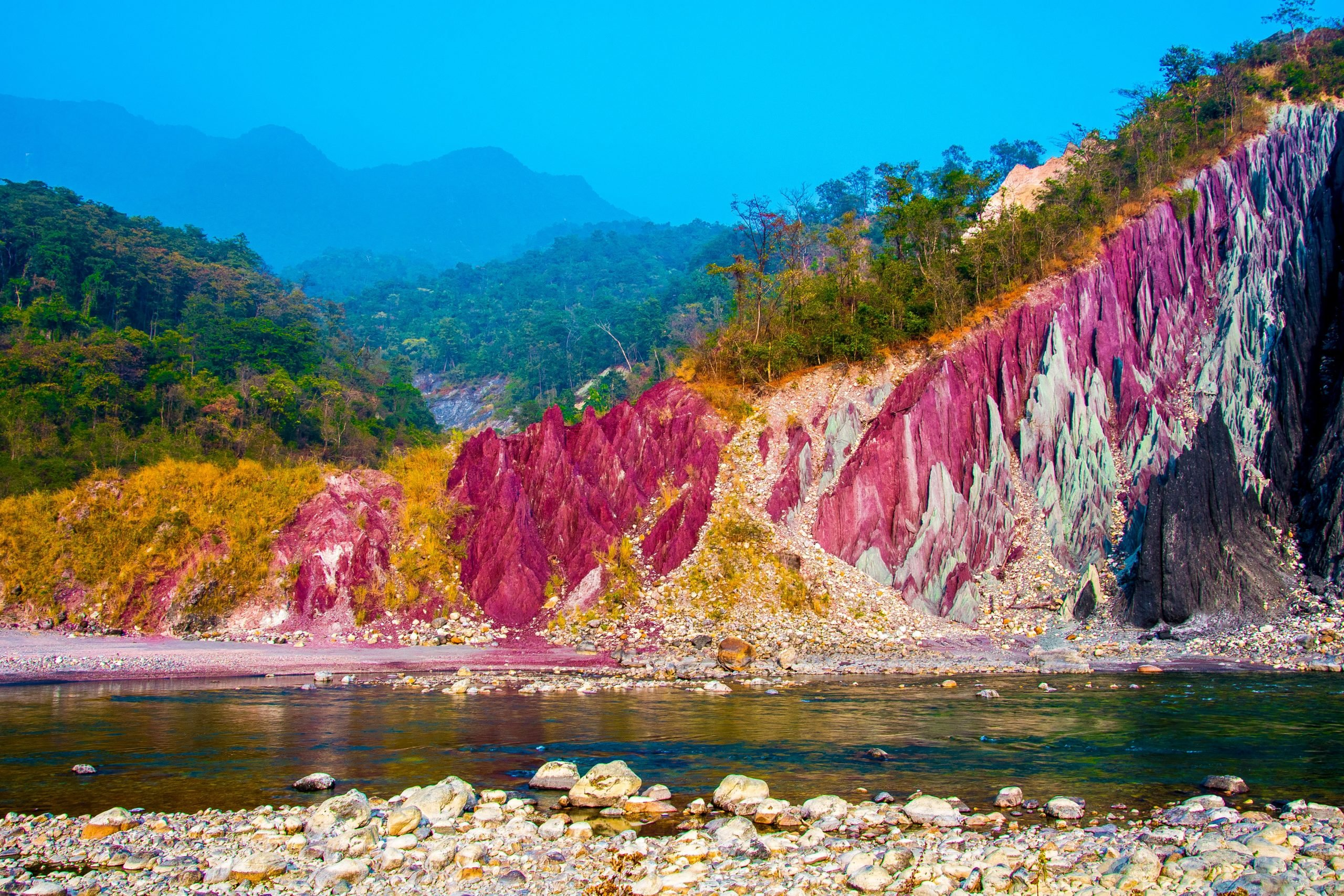 A river under colorful mountains