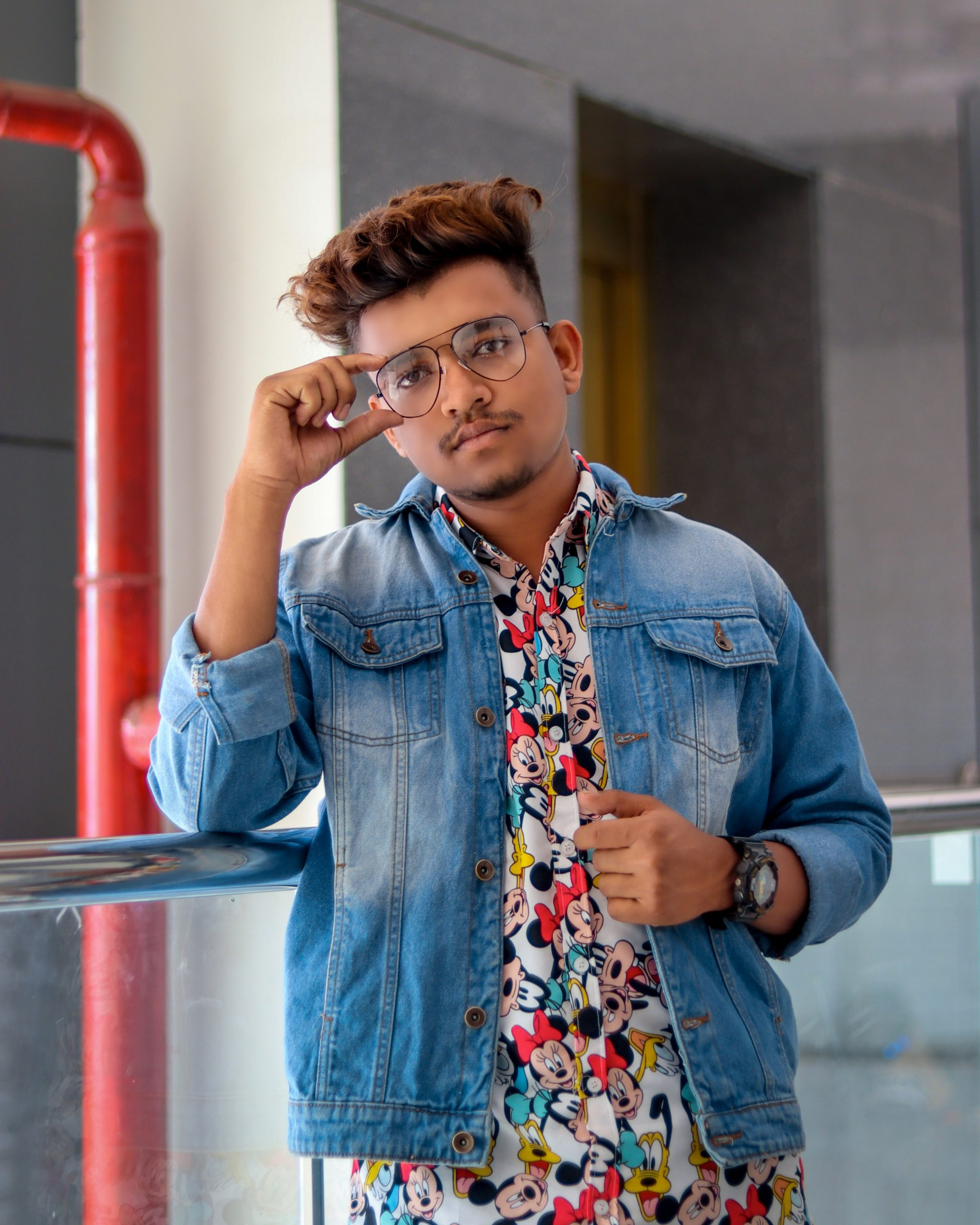 A stylish boy posing with specs