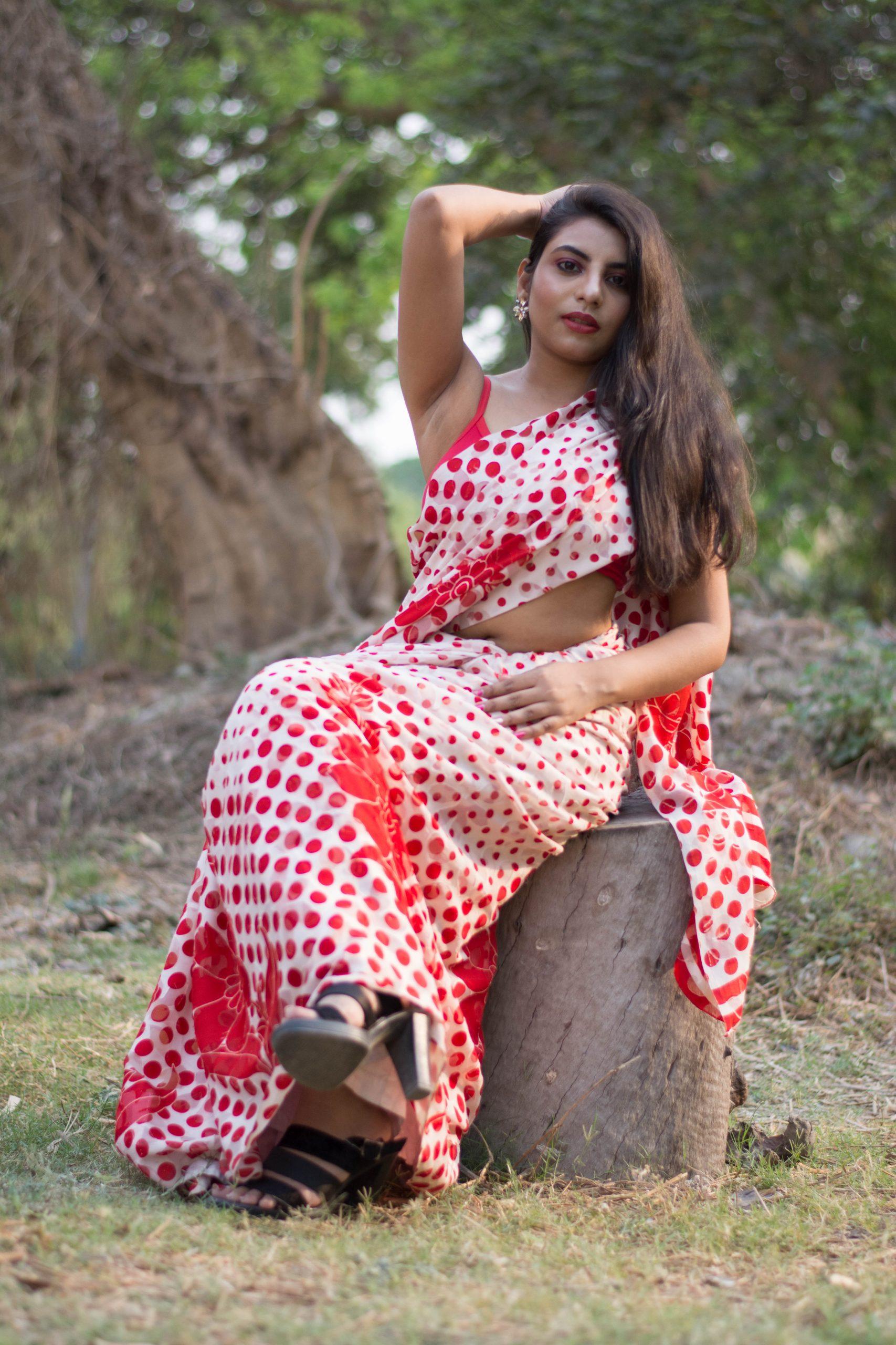 A woman sitting on a tree stump