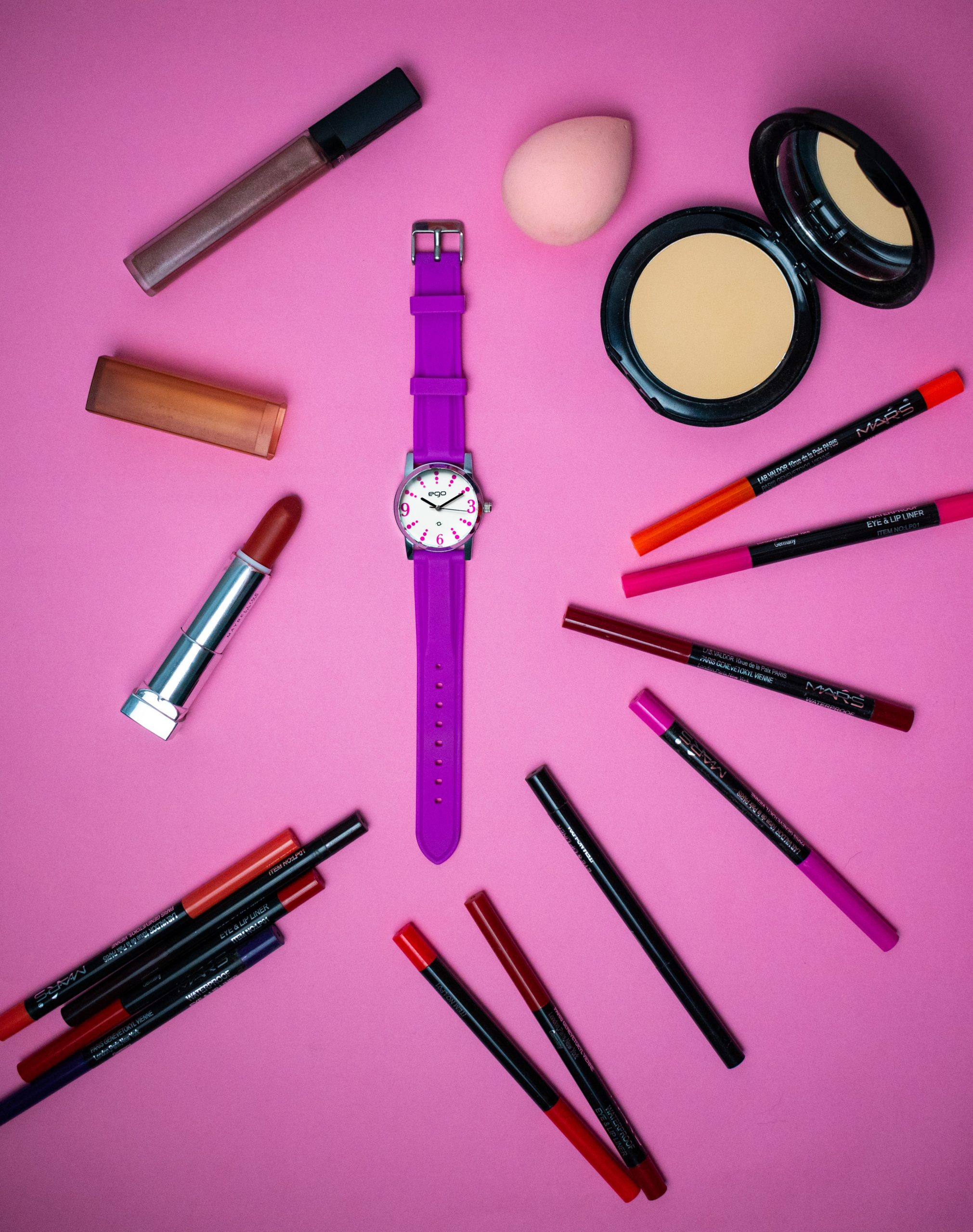 A wrist watch and cosmetic items