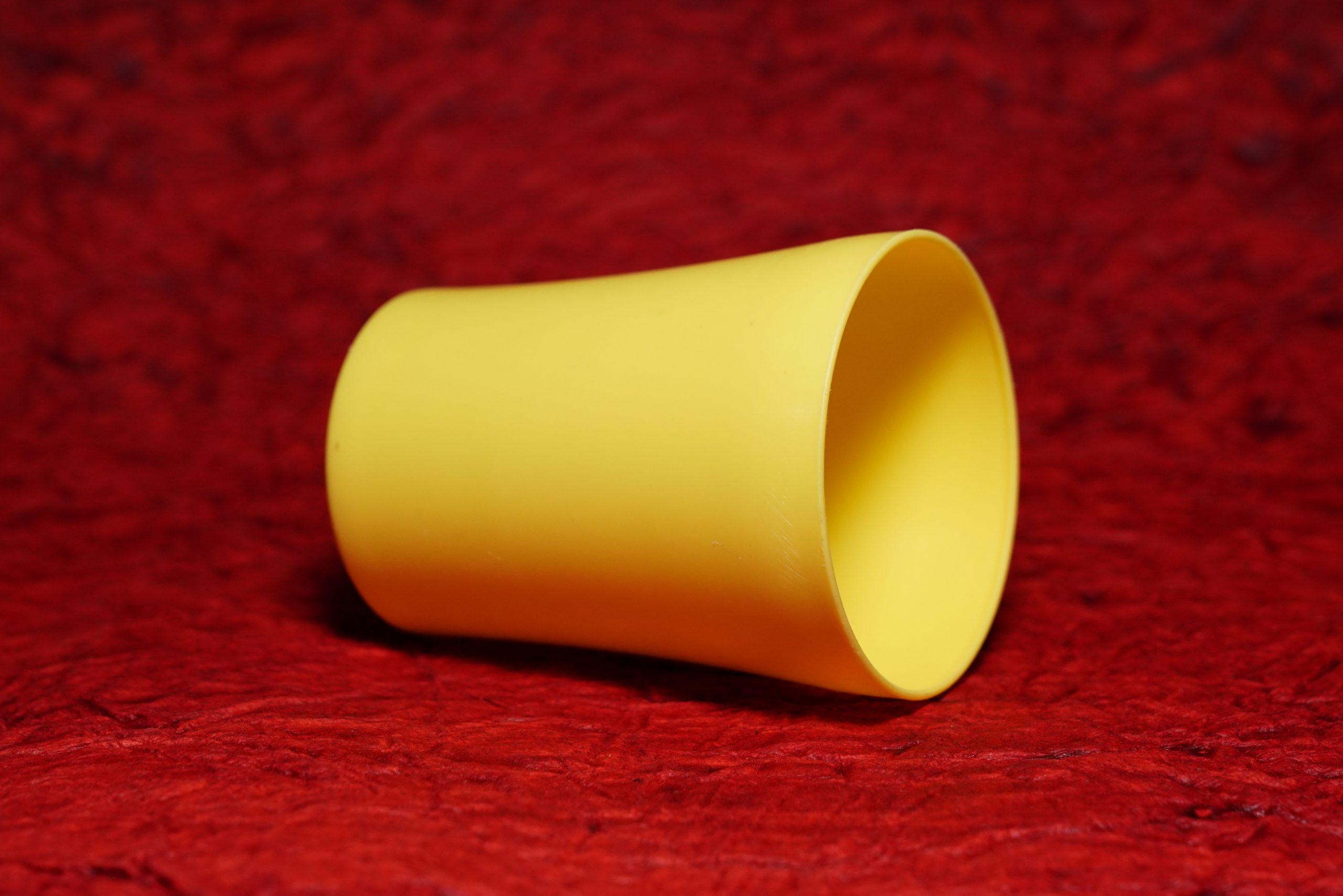 A yellow plastic tumbler
