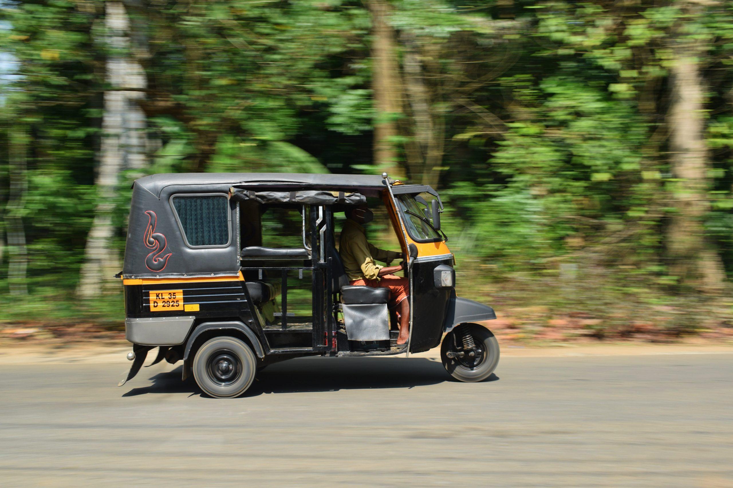 Panning shot of a Auto rickshaw on road