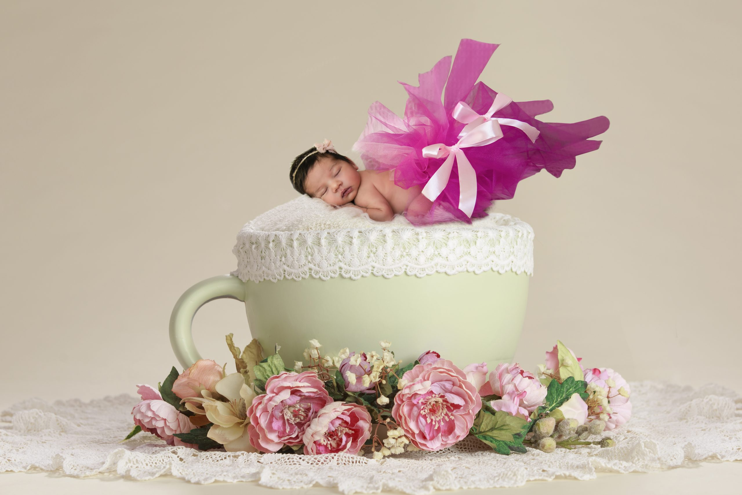 Showing a baby sleeping on a cup cushion