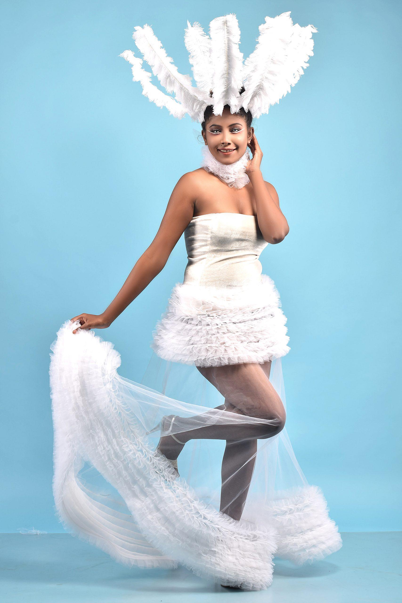 Beautiful female model in Angel's dress