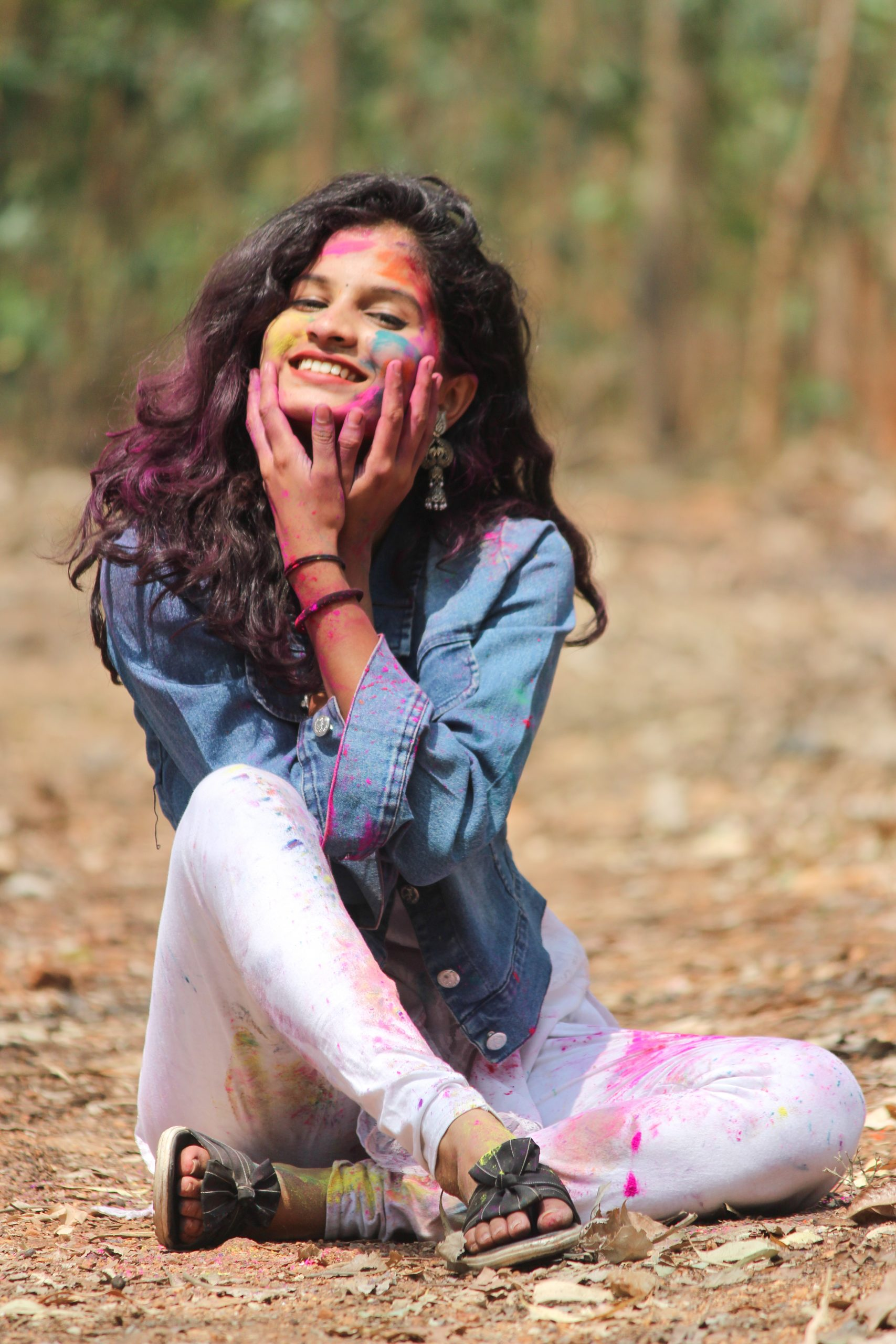Beautiful female model posing with Holi colors