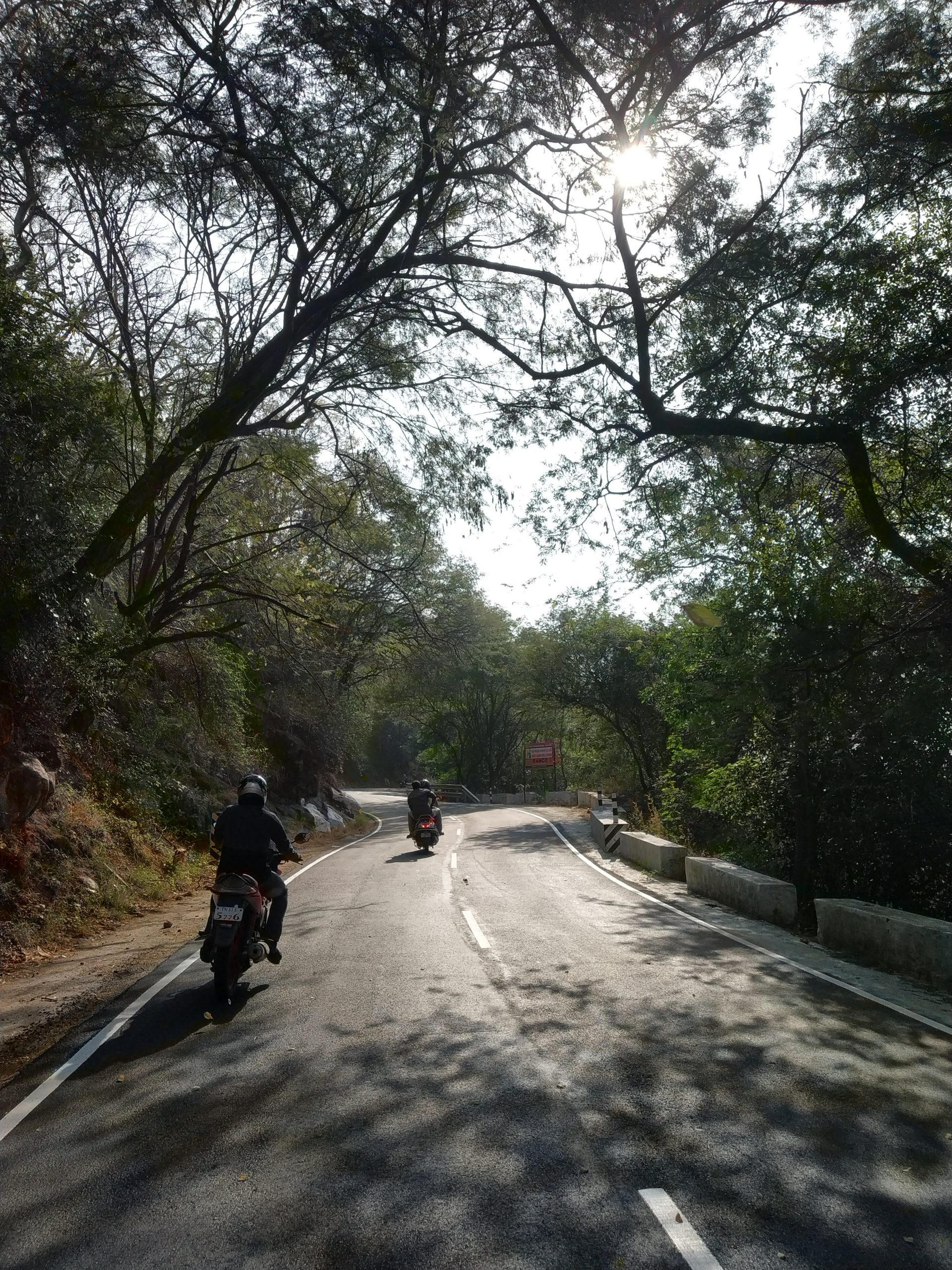 Bikes passing through a hill station road