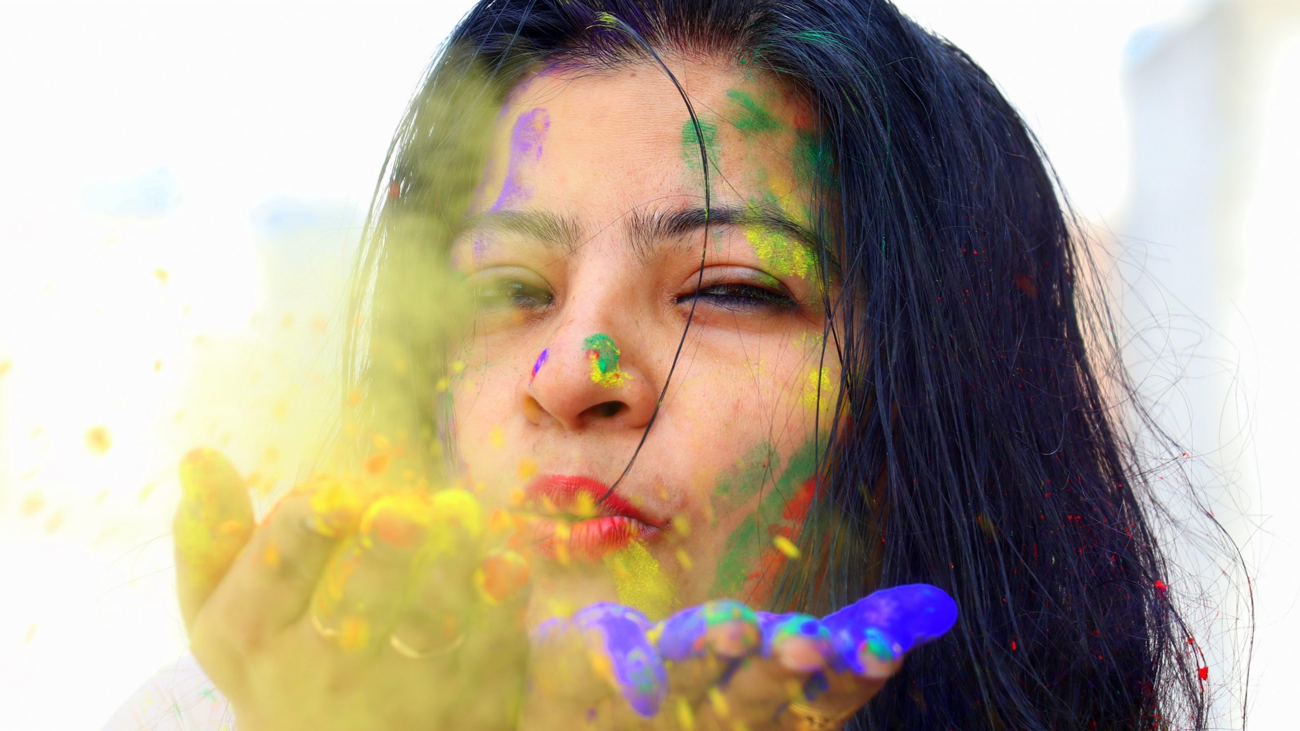 Girl blowing colors