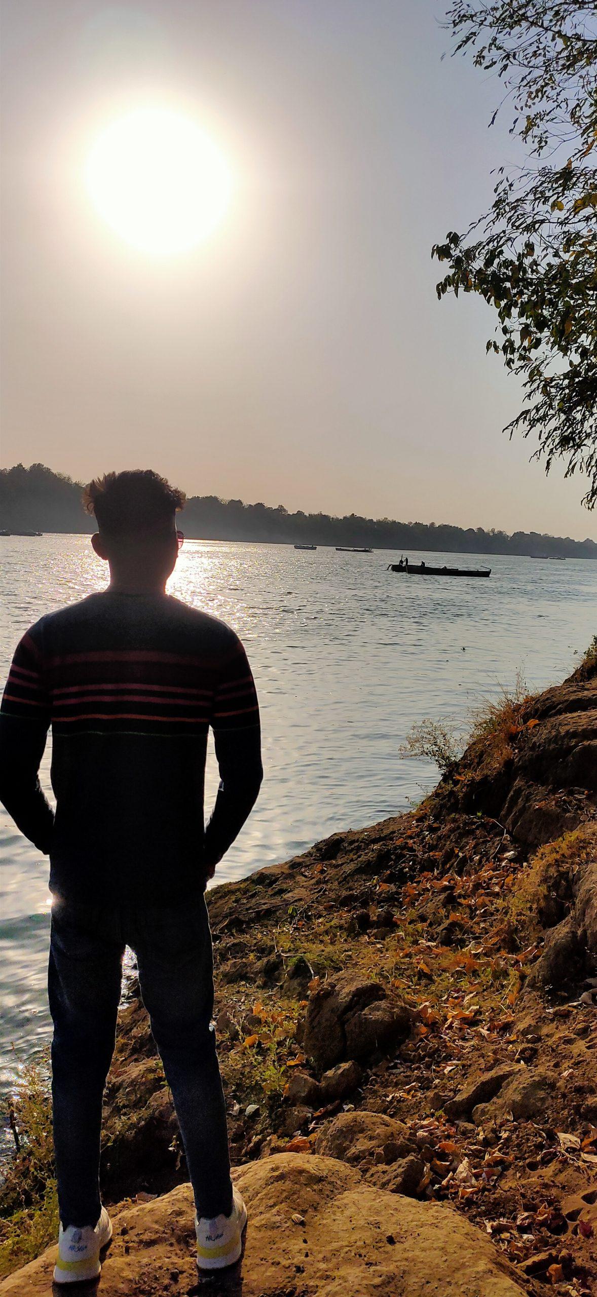 Boy posing river side