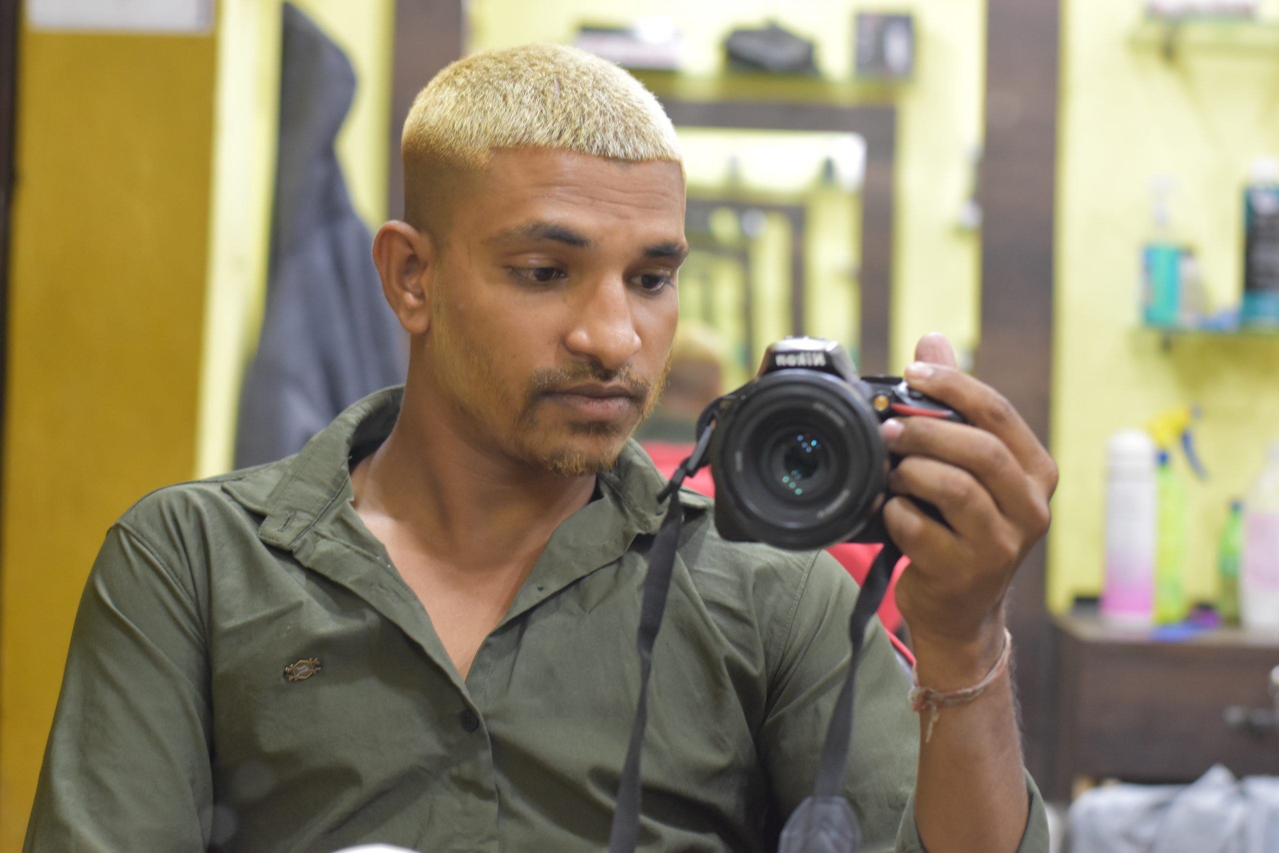Boy clicking picture with camera
