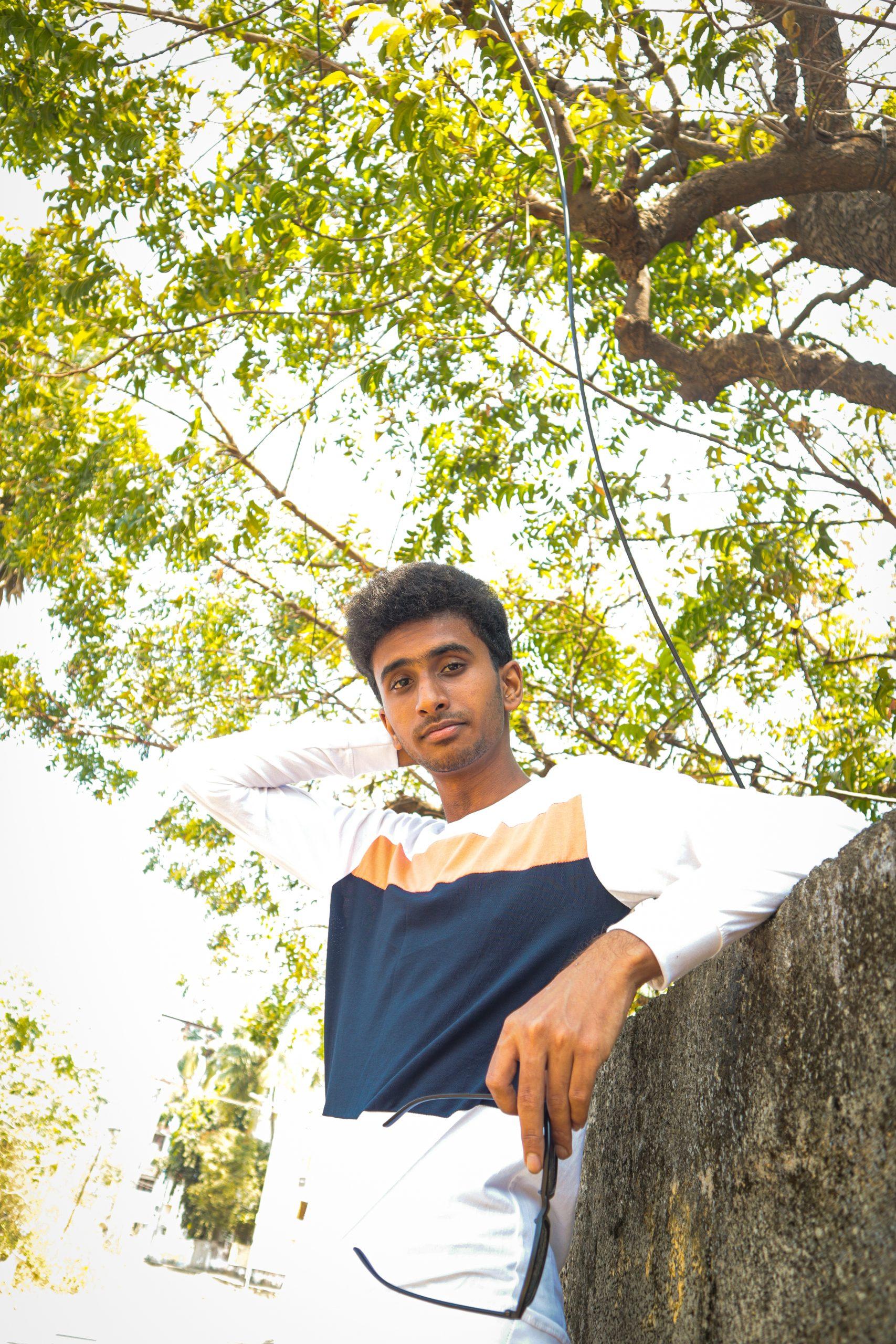Boy posing near the wall