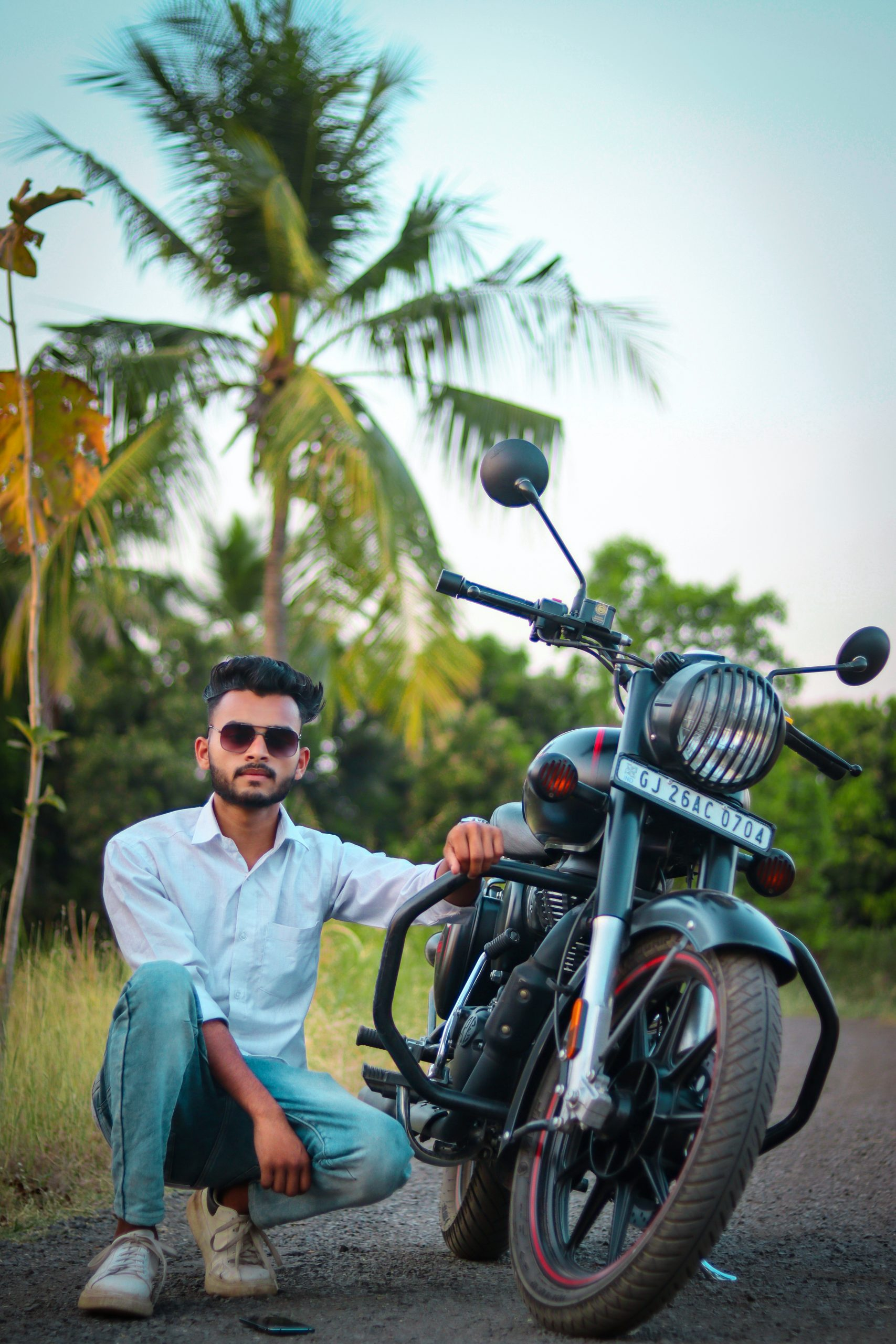 Boy posing with Royal Enfield bike