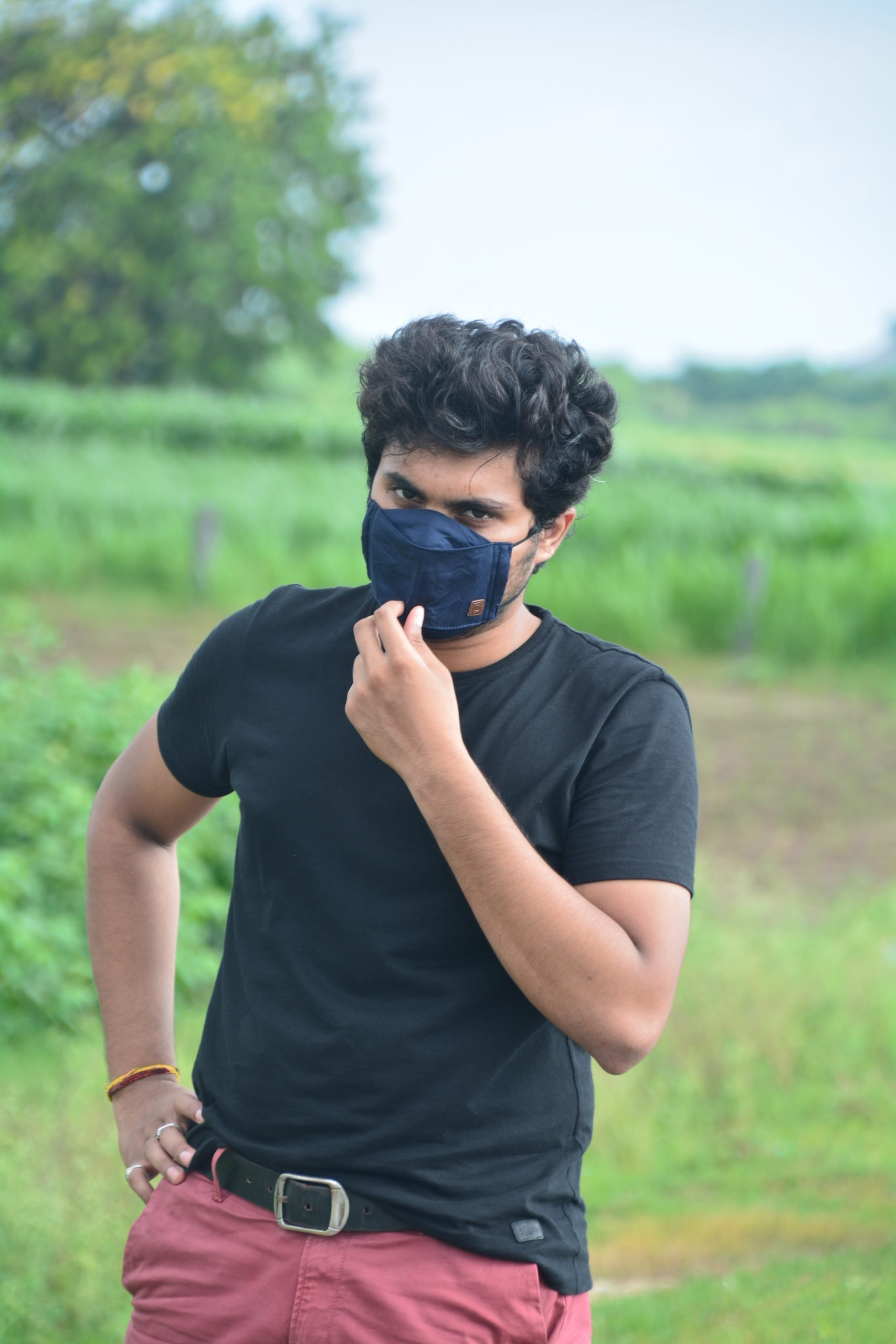 Boy posing with mask