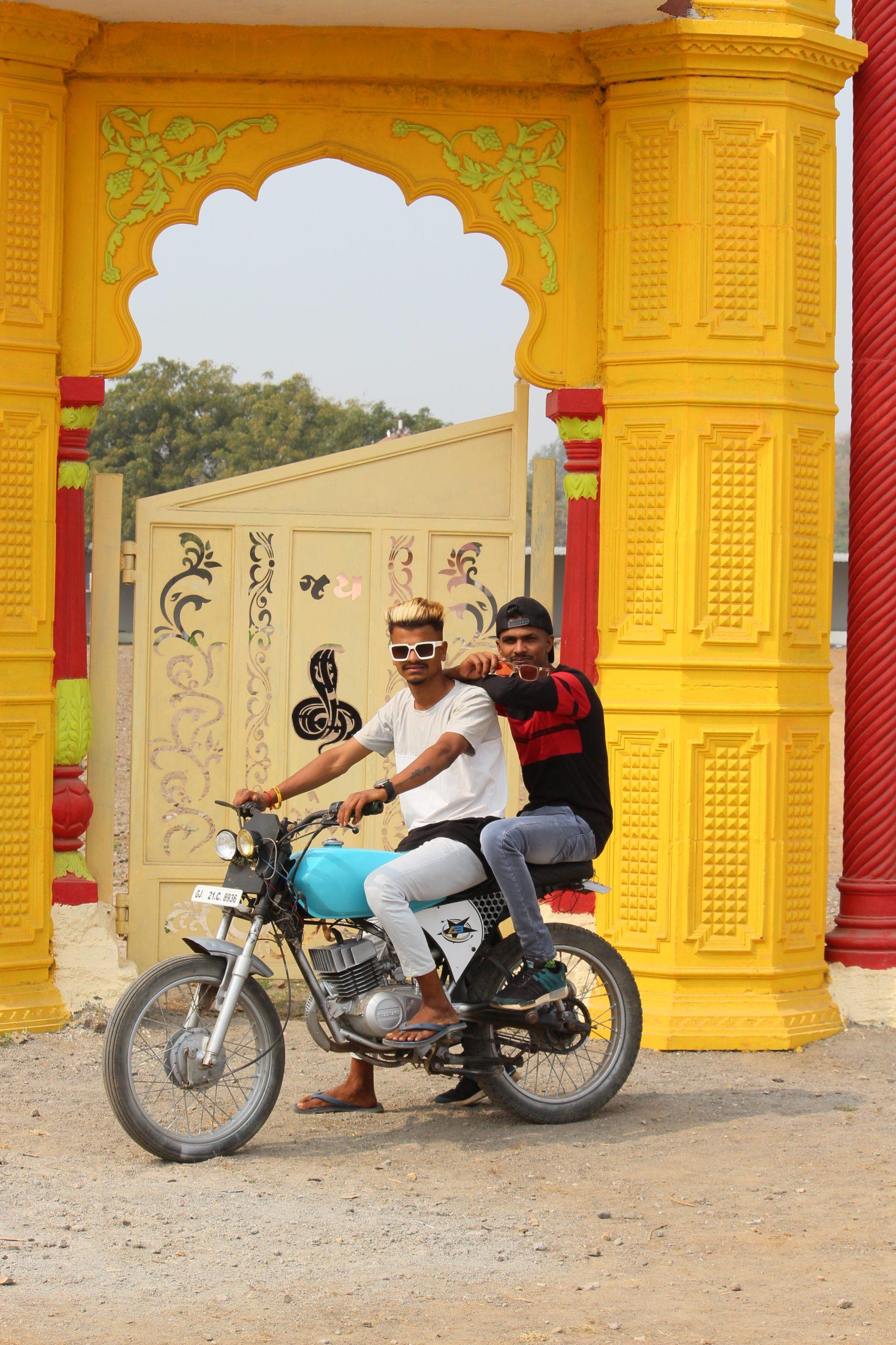 Boys posing on the bike