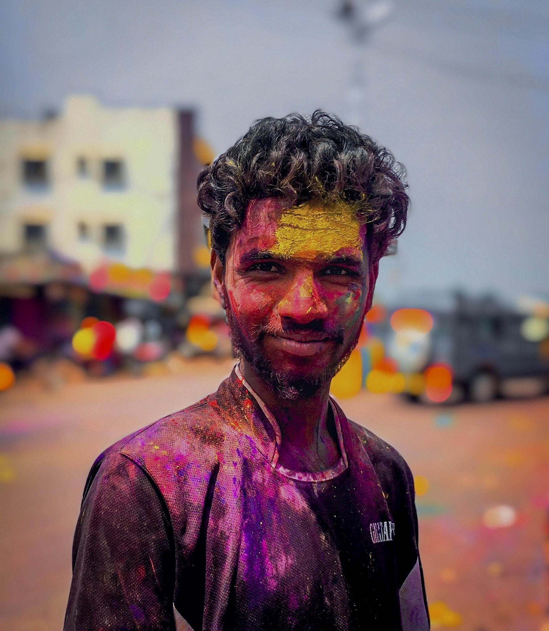 A boy's face painted with Holi colors