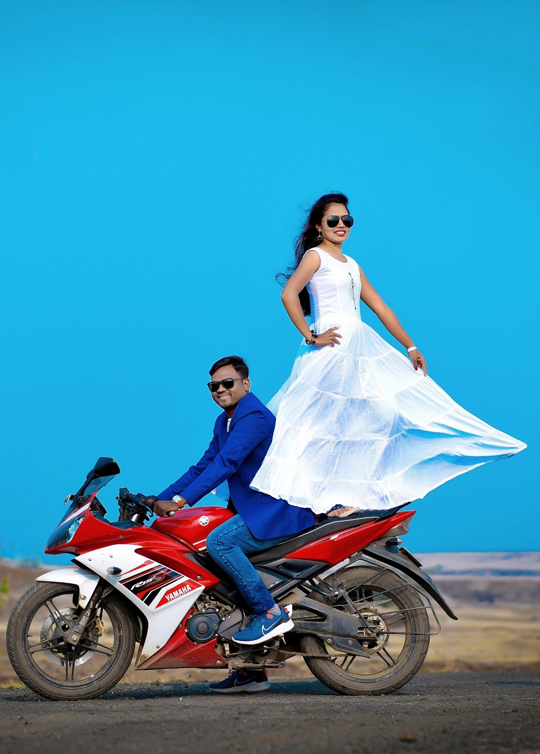 Couple posing on the bike