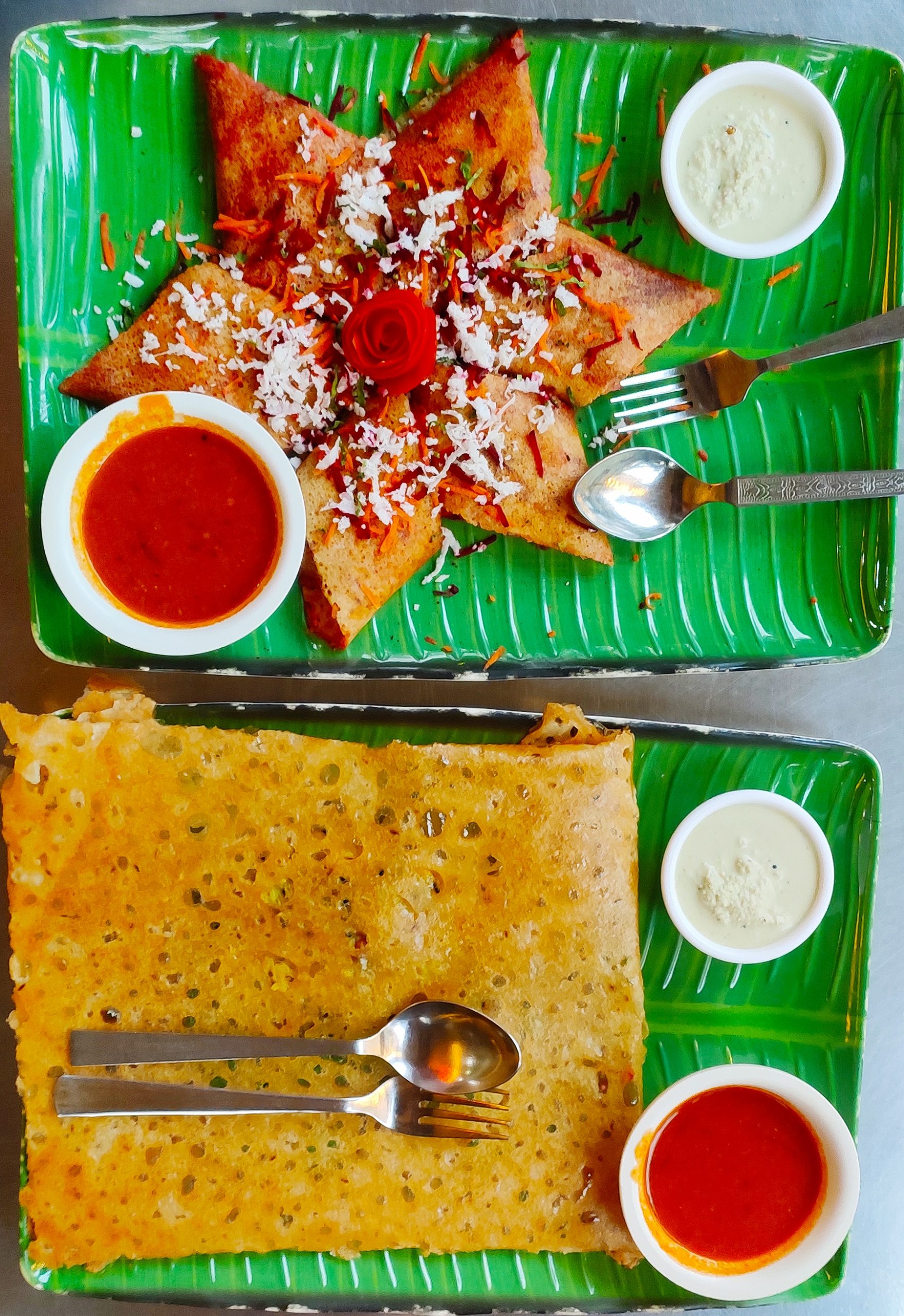 Dosa in banana leaf shaped plate