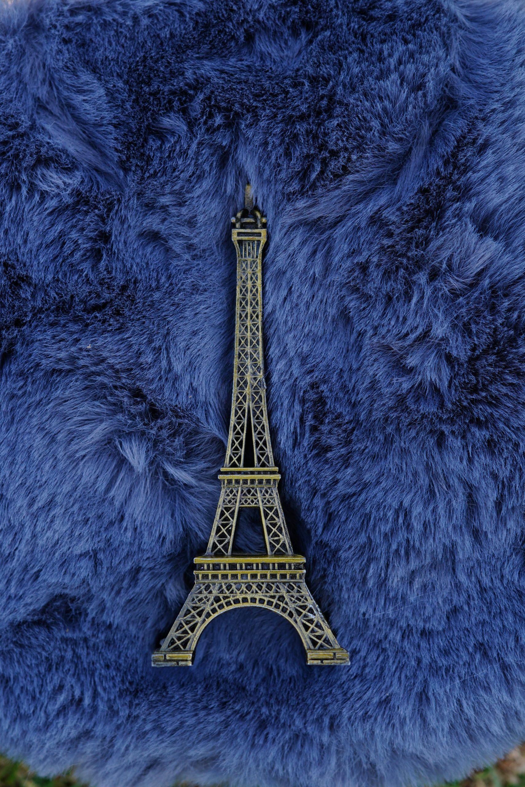 Eiffel tower toy on a woolen