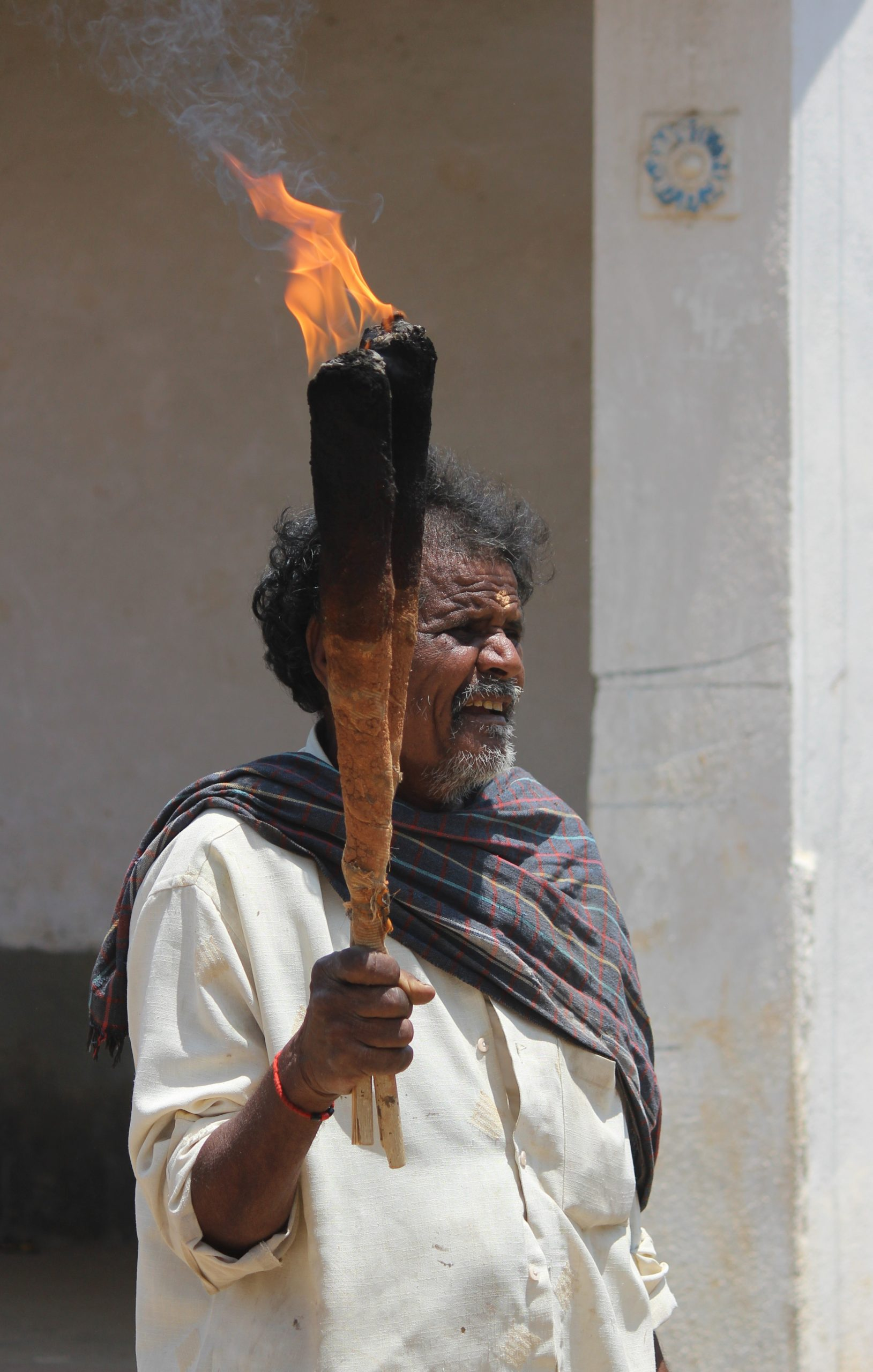 A man holding a fire torch