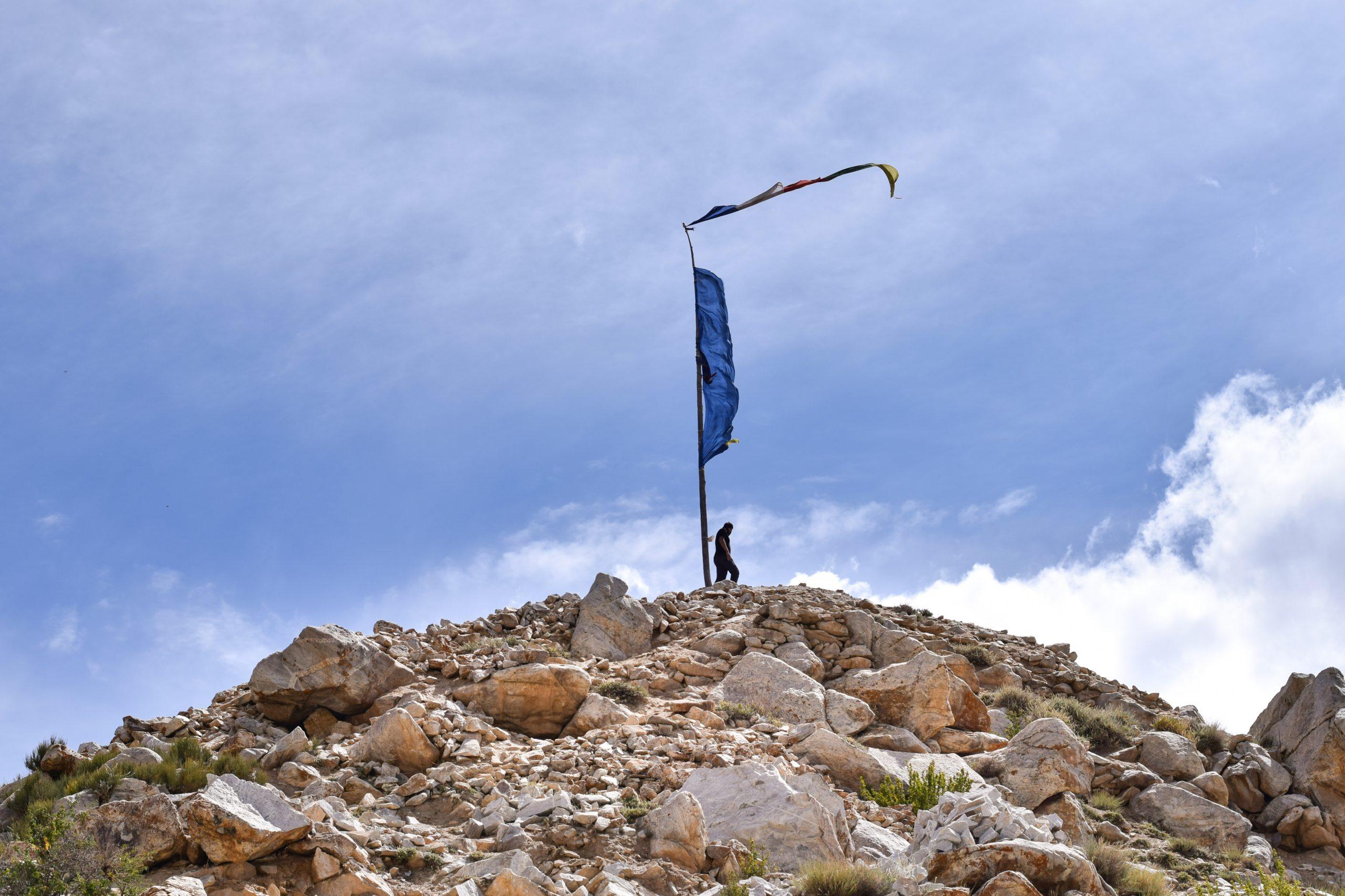 Flag on mountain top