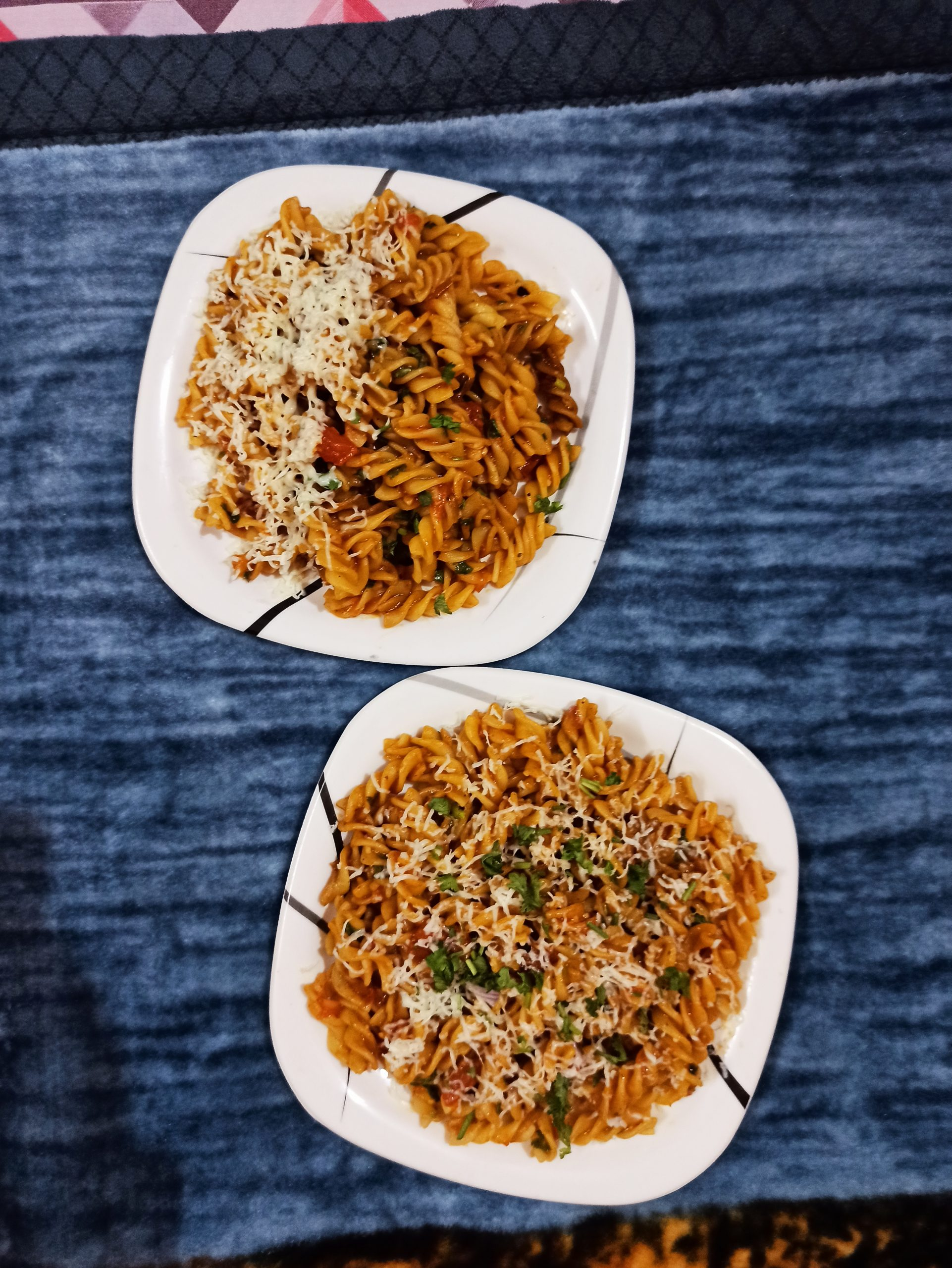 Fusilli pasta in plates