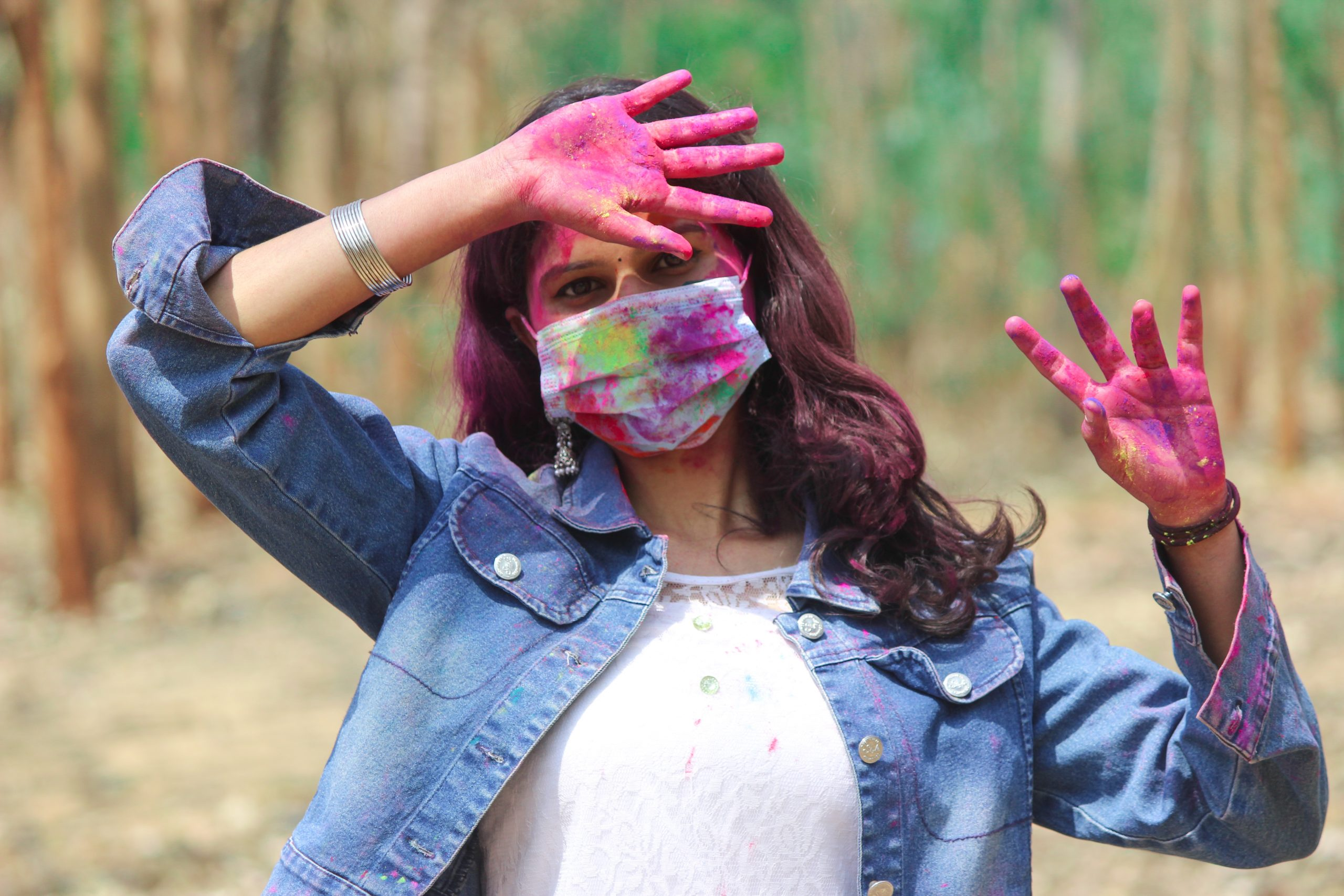 Girl playing Holi with mask