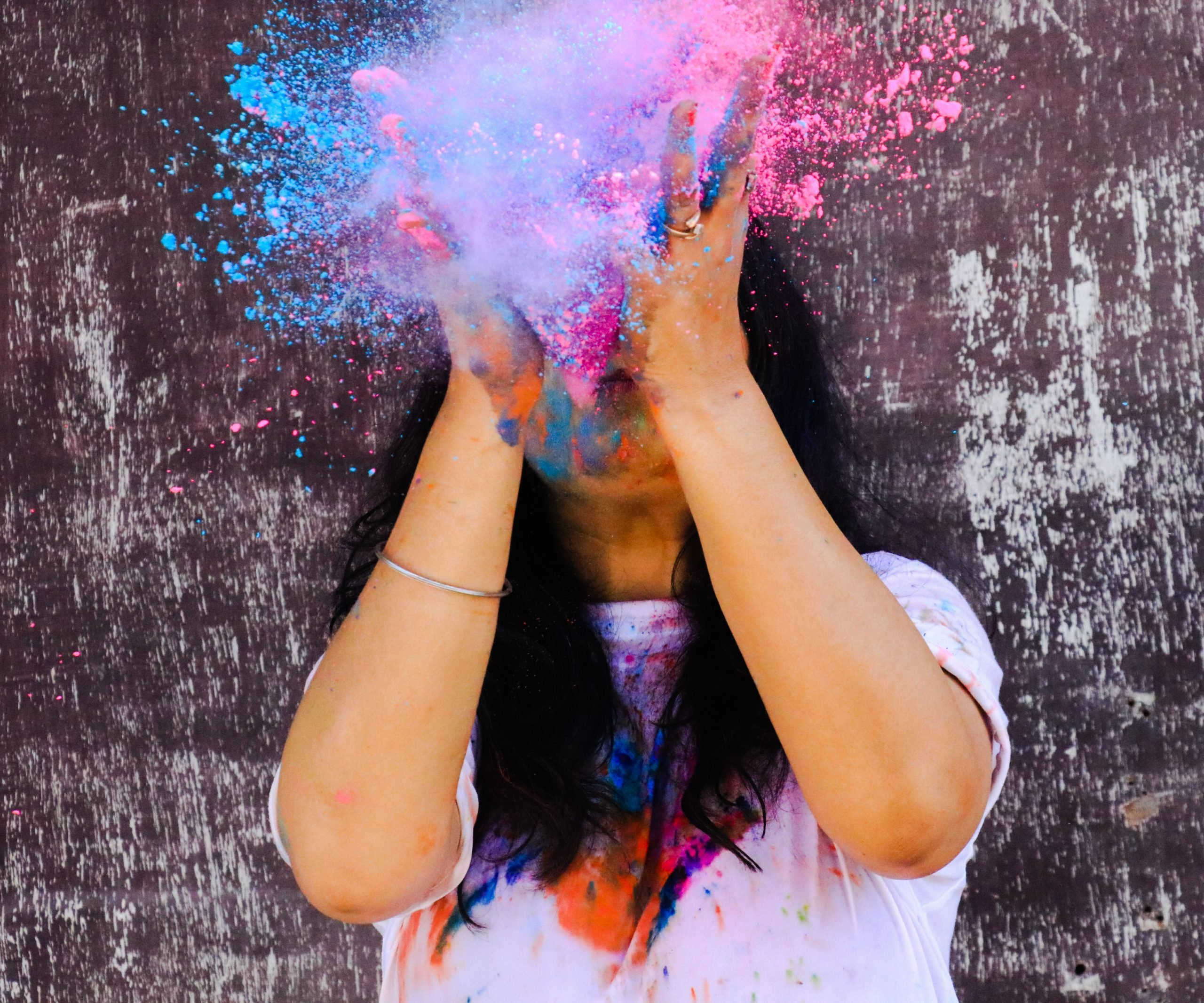 Girl playing with Holi colors