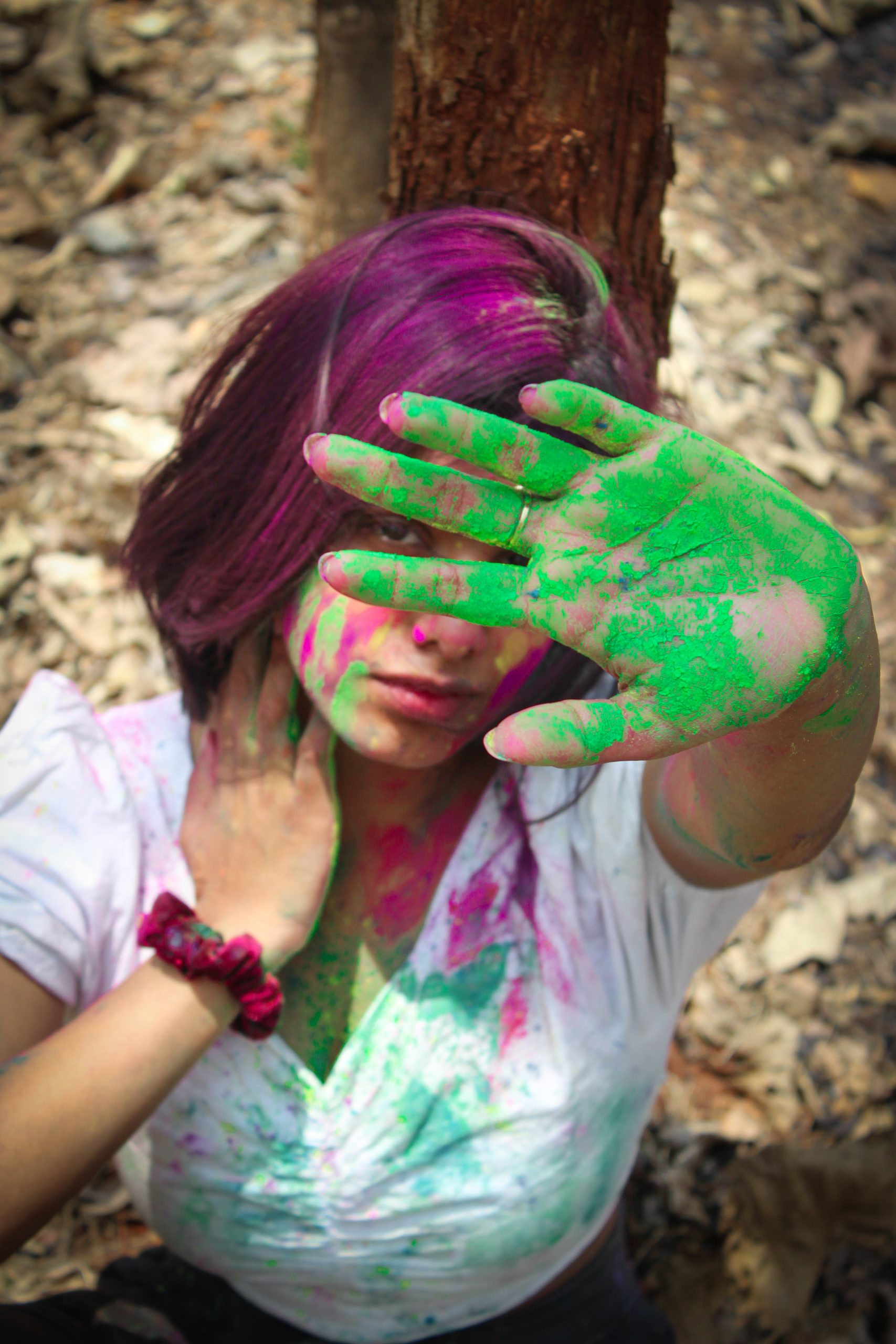Girl posing with Holi colors,