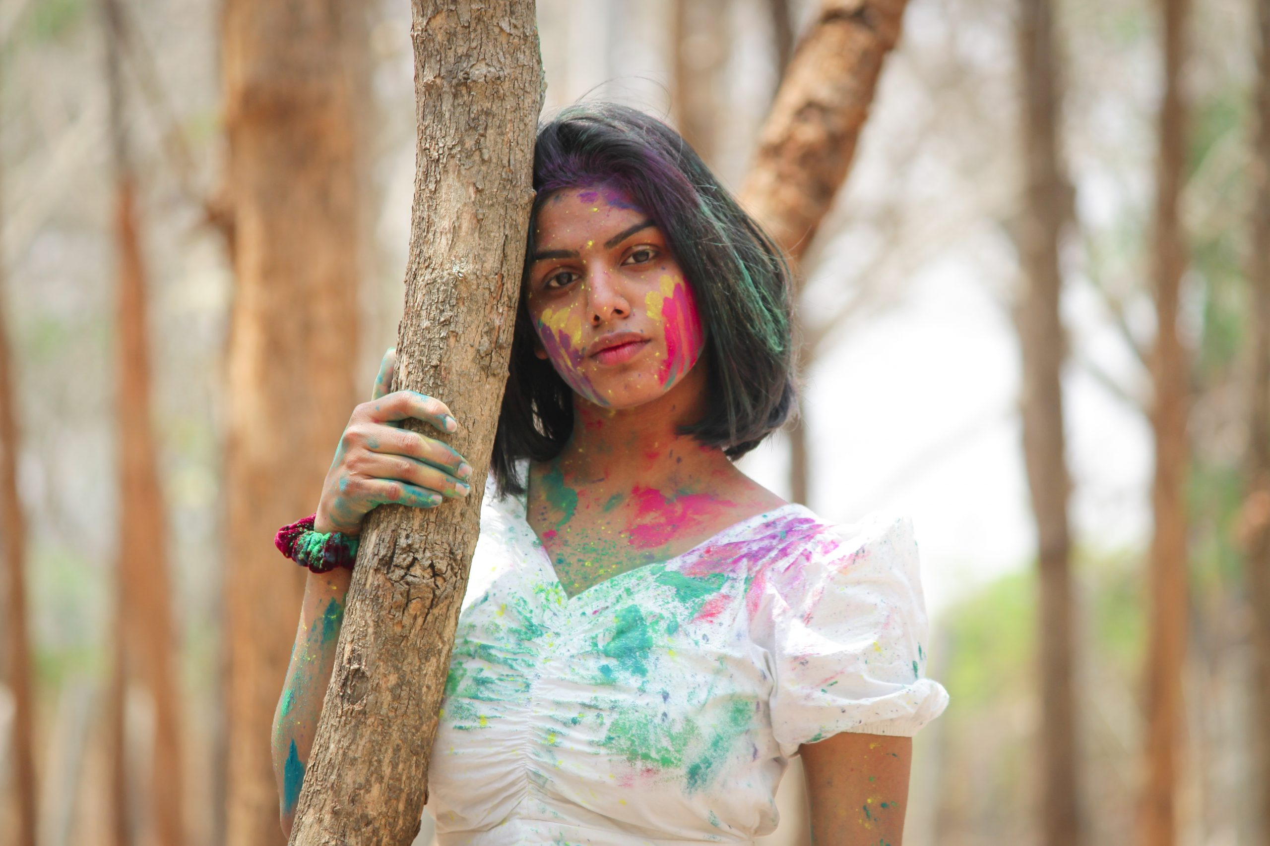 Girl posing with Holi colors on her face