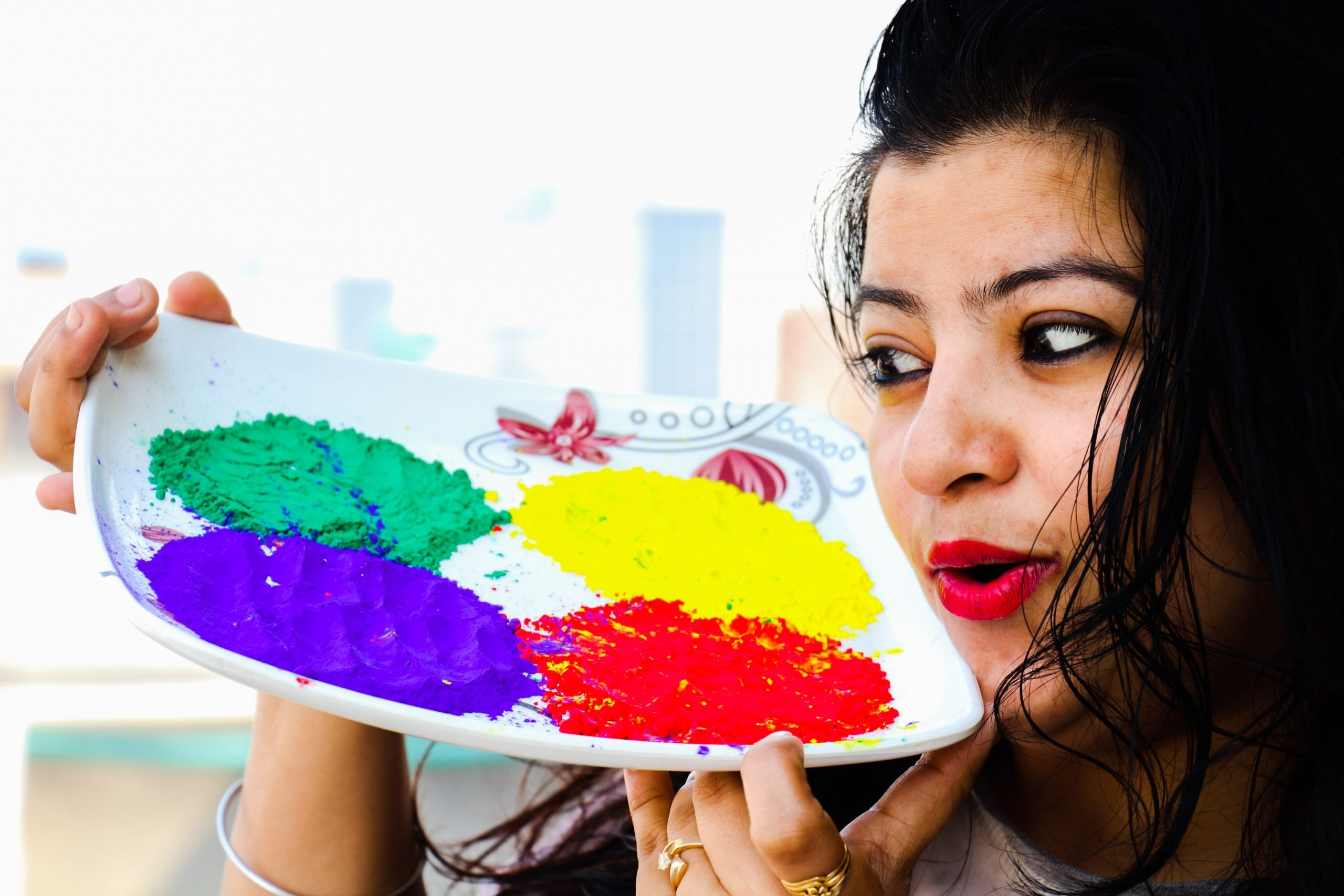 Girl with Holi colors in plate