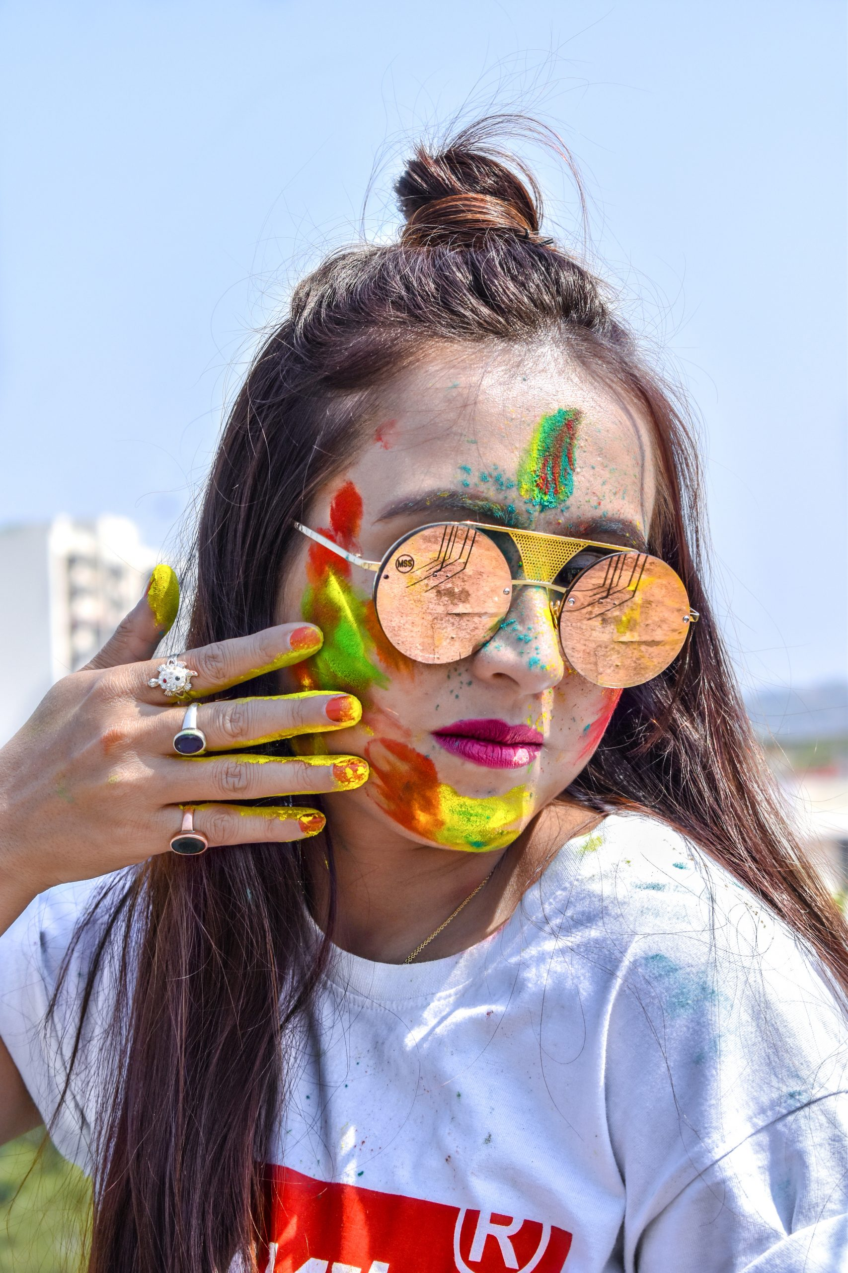 Girl with long hair ready for celebrating Holi
