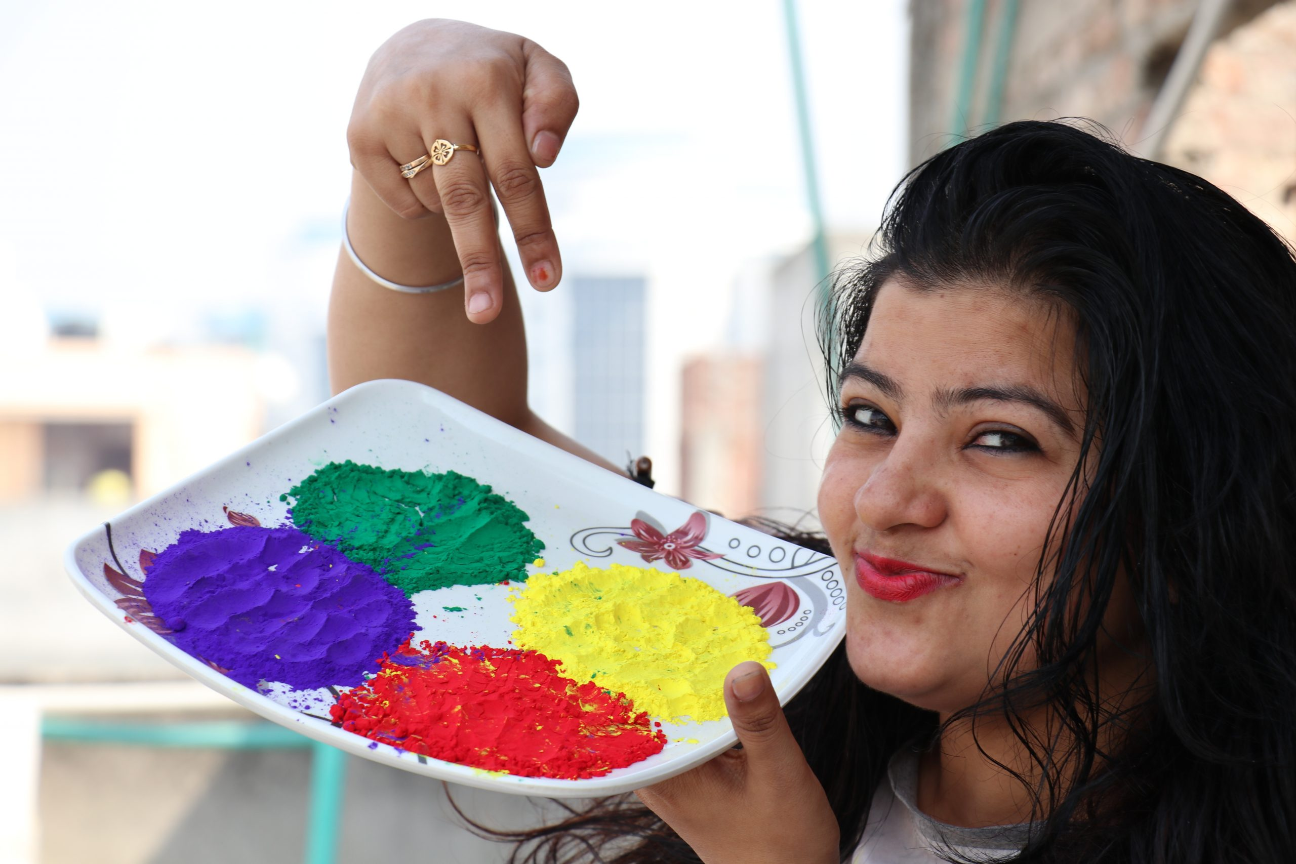 Girl pointing towards plate full of colors
