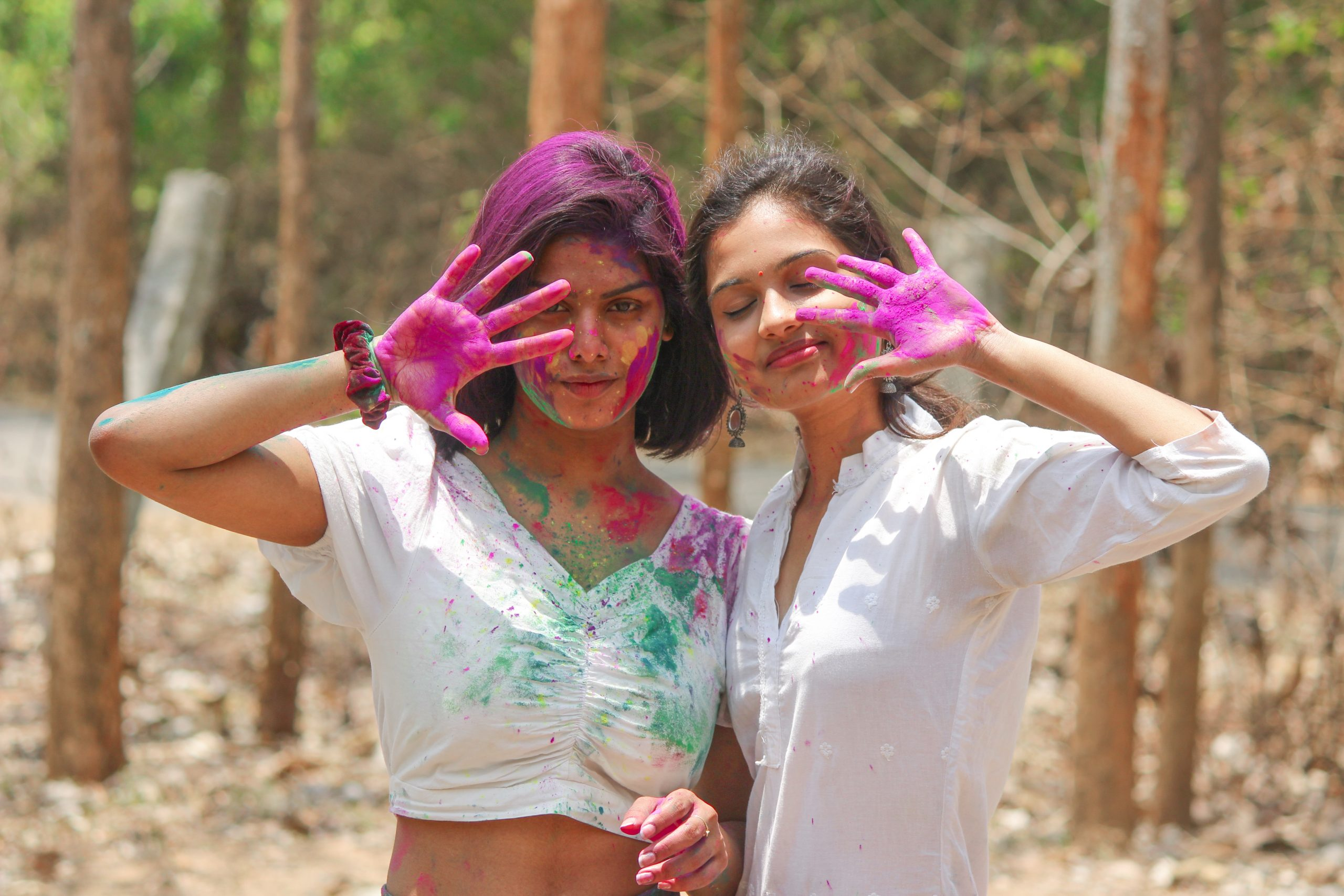 Girls playing with Holi colors