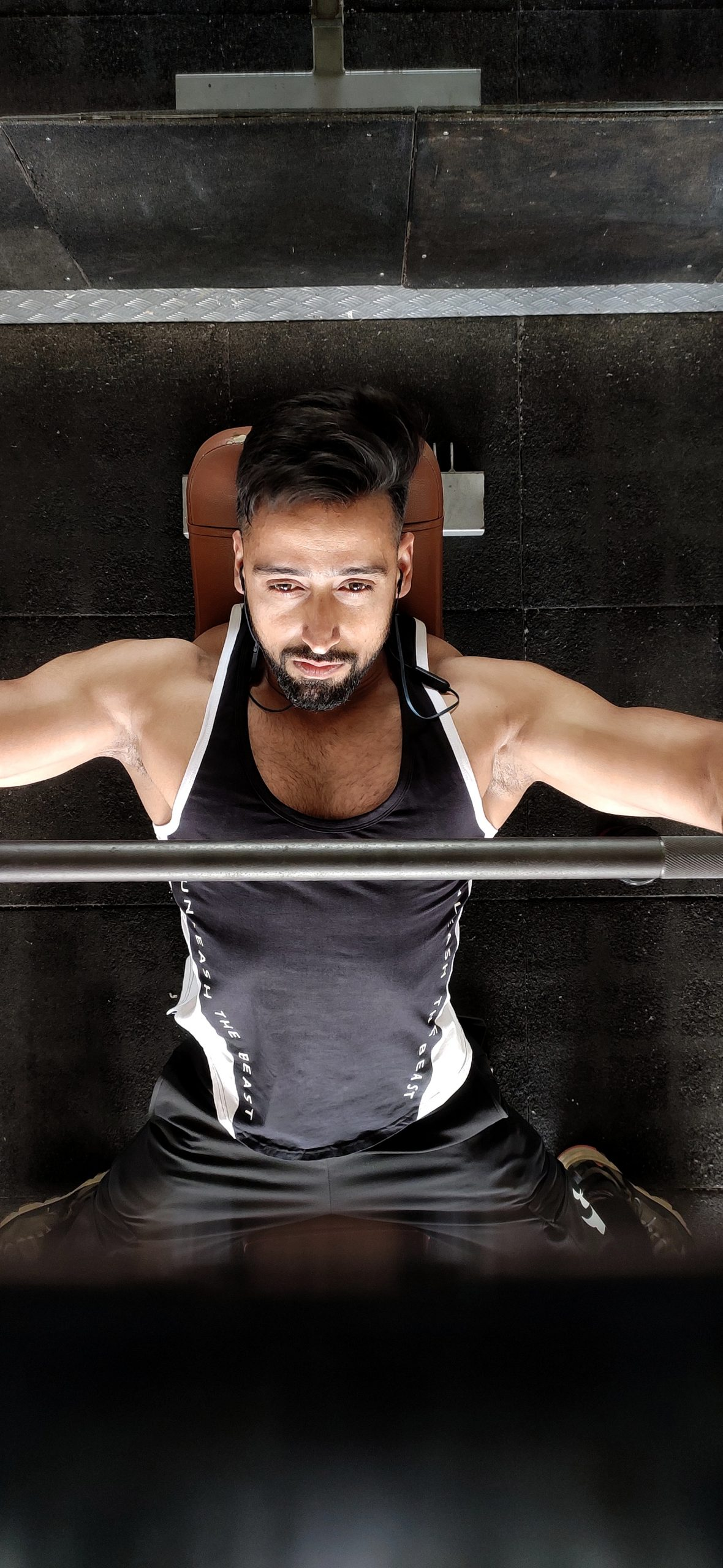 A boy working out in a gym