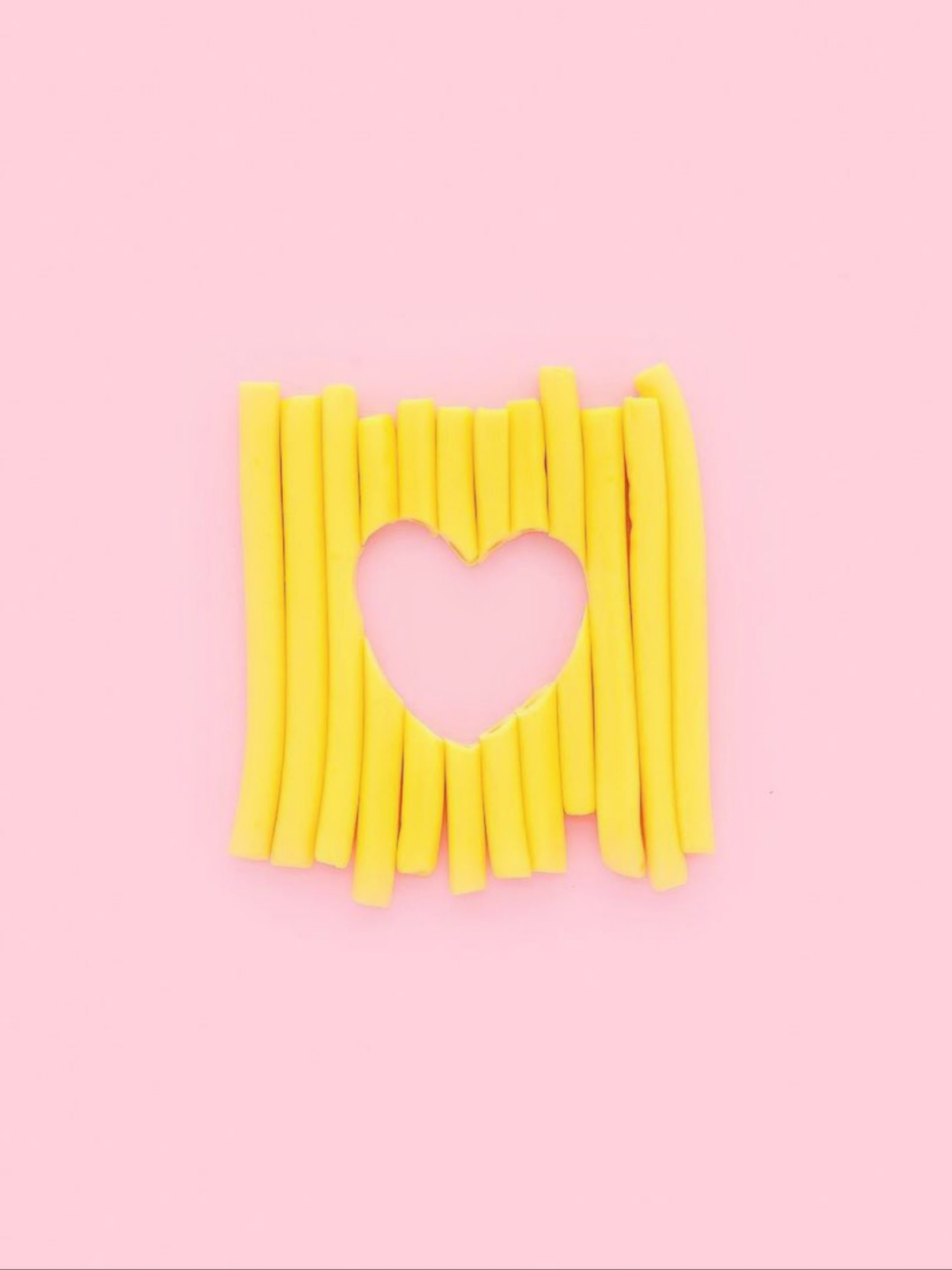 Heart shape made with yellow sticks