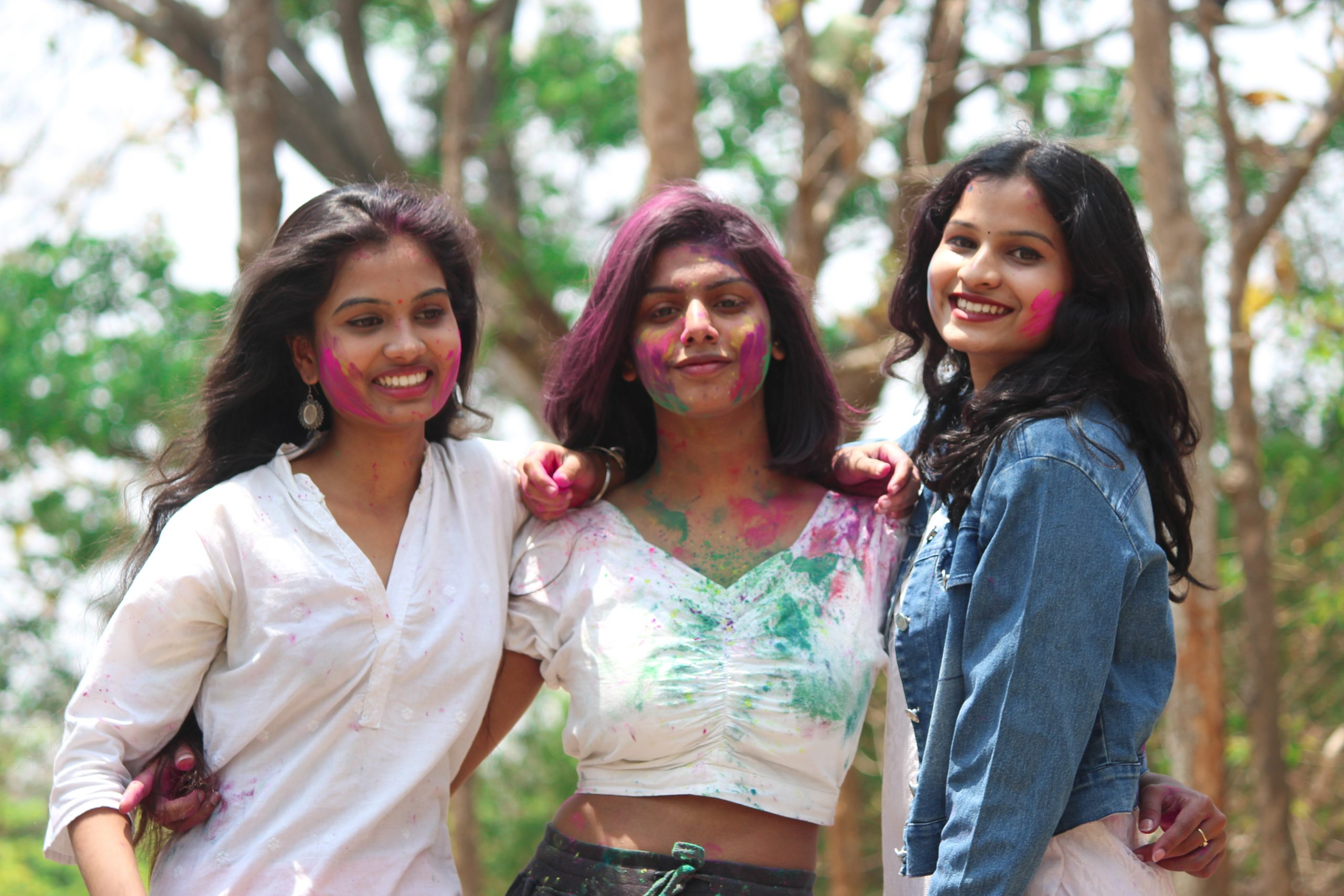 Girls posing with Holi colors