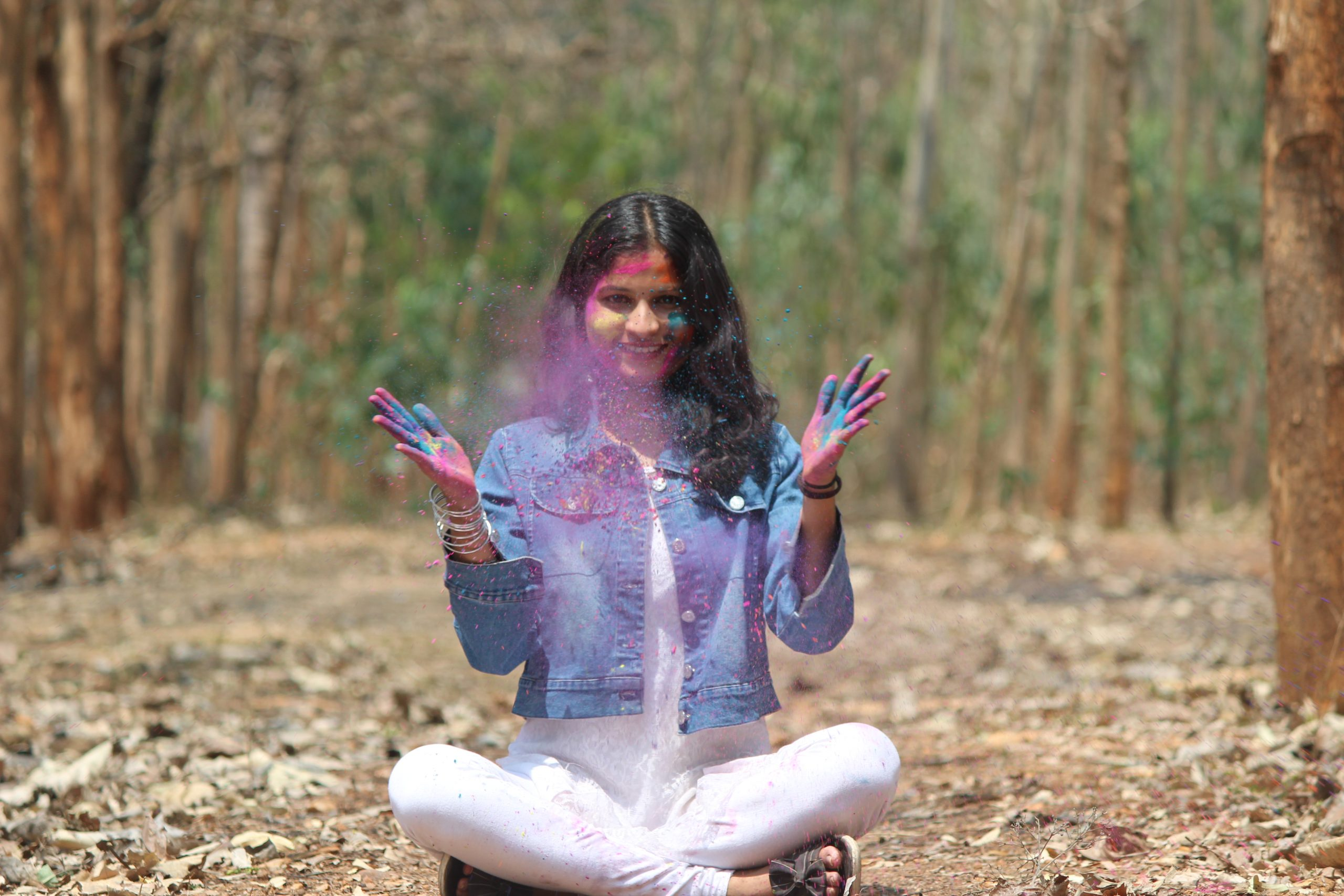 A girl playing with Holi colors