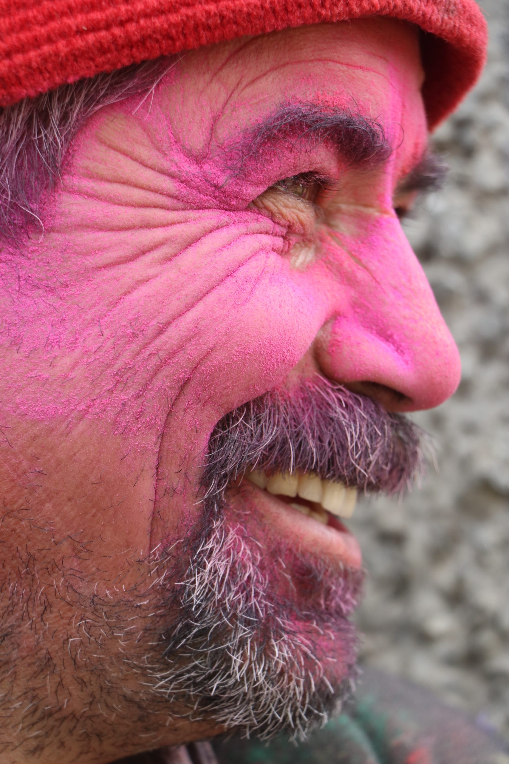 Man covered in colors smiling
