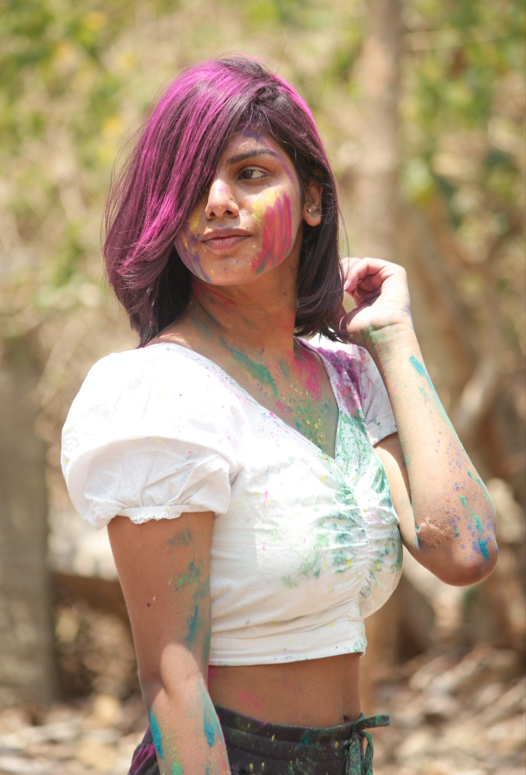 Holi colors on beautiful Girl's hair and face