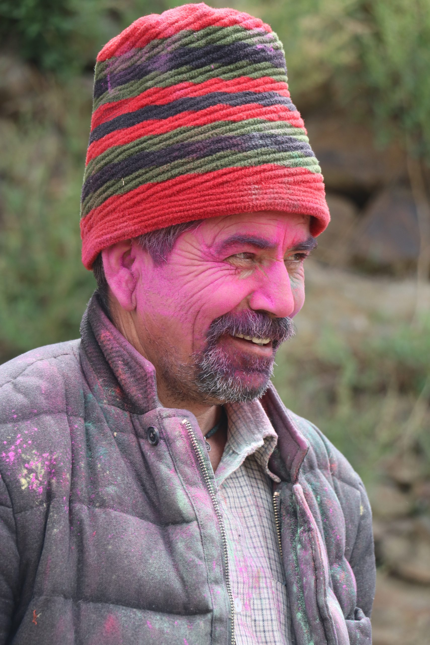 A happy man celebrating holi festival