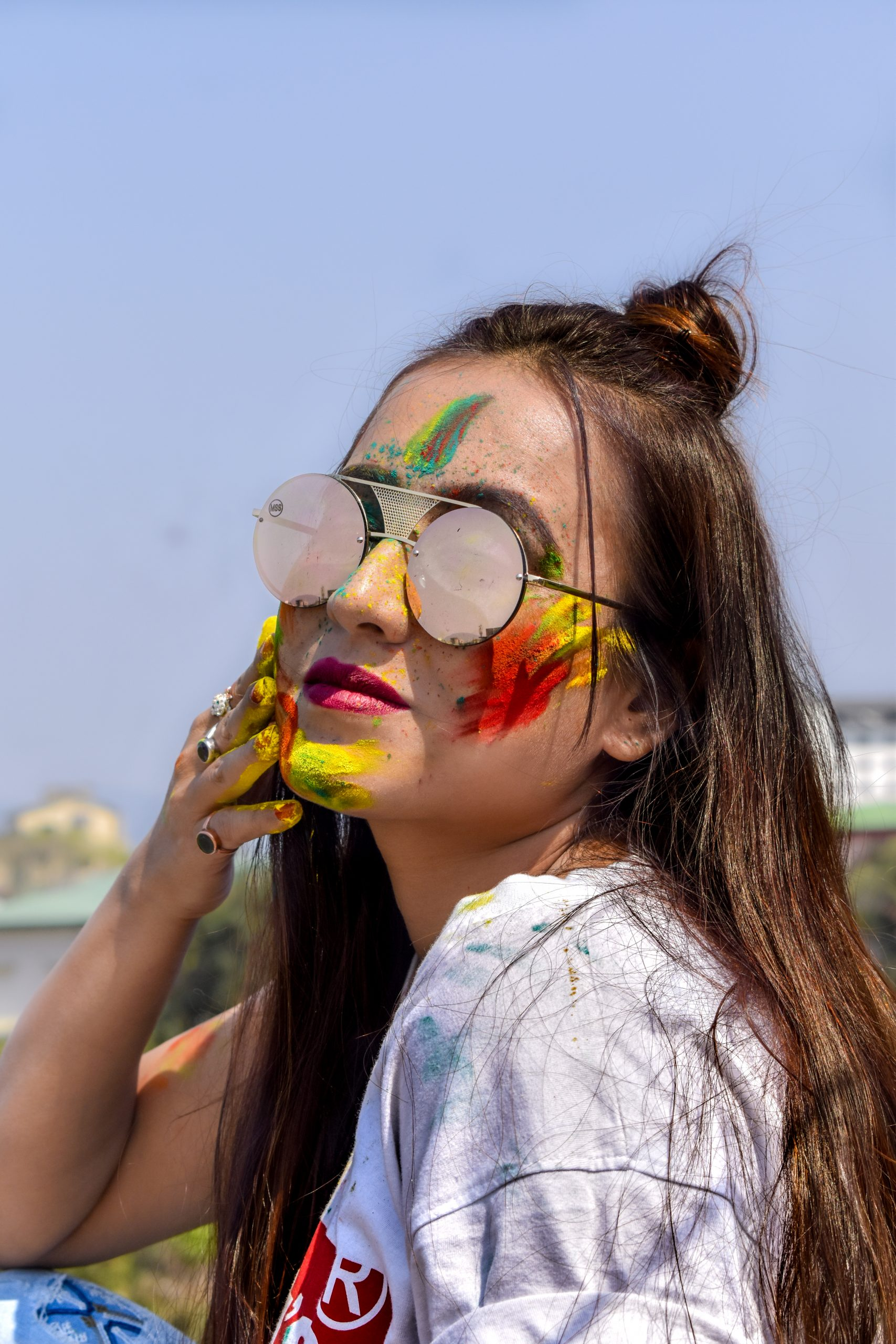 Long hair girl with sunglasses playing with colors