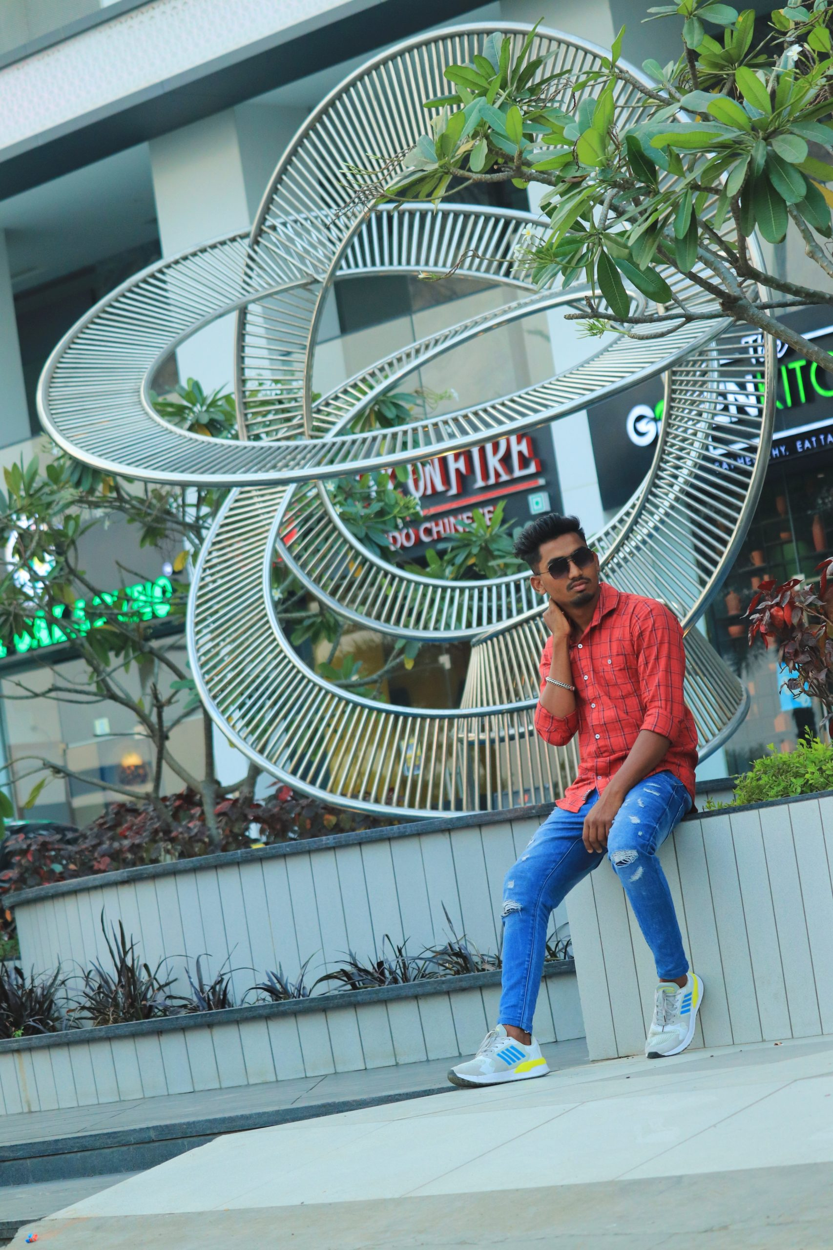 Model posing outside the shopping complex