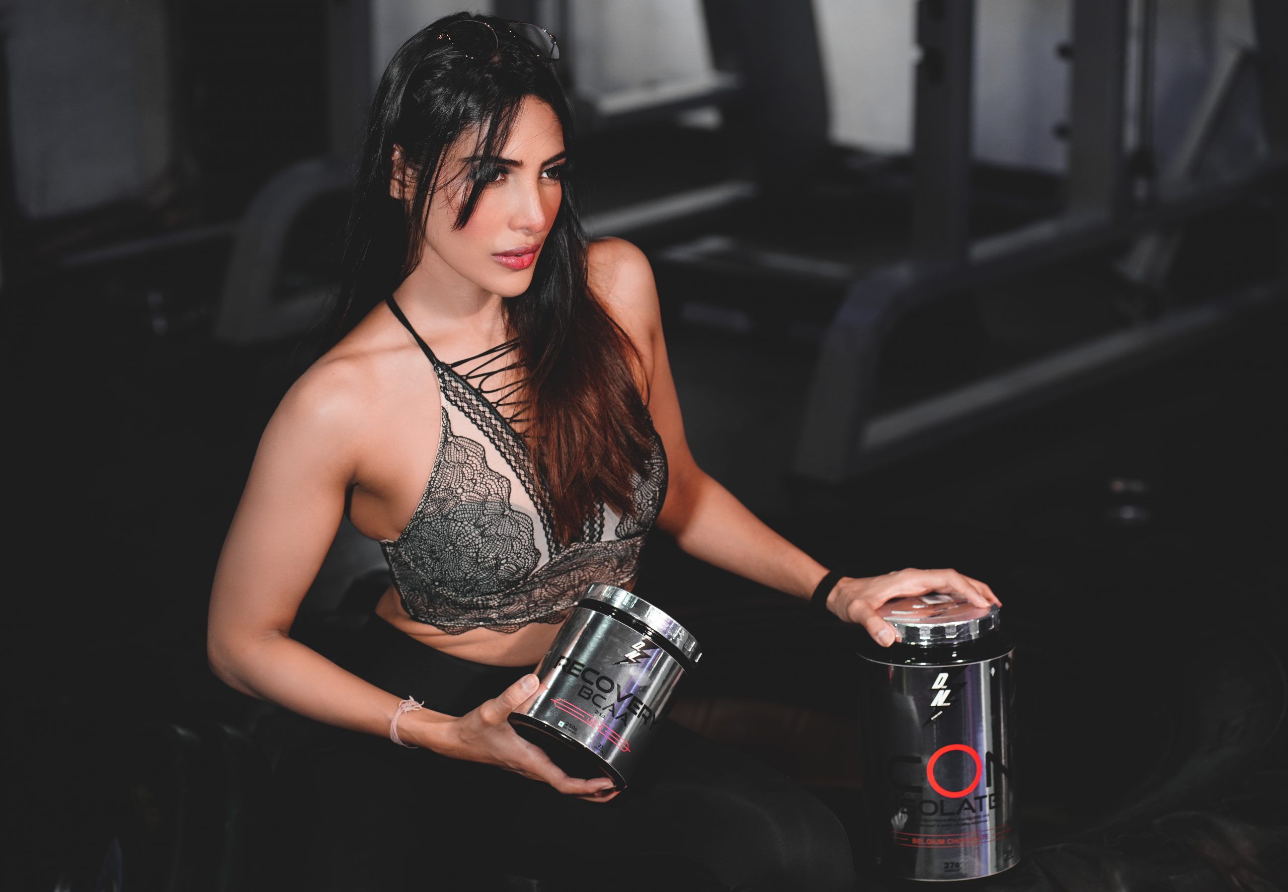 Female model posing with Supplement box