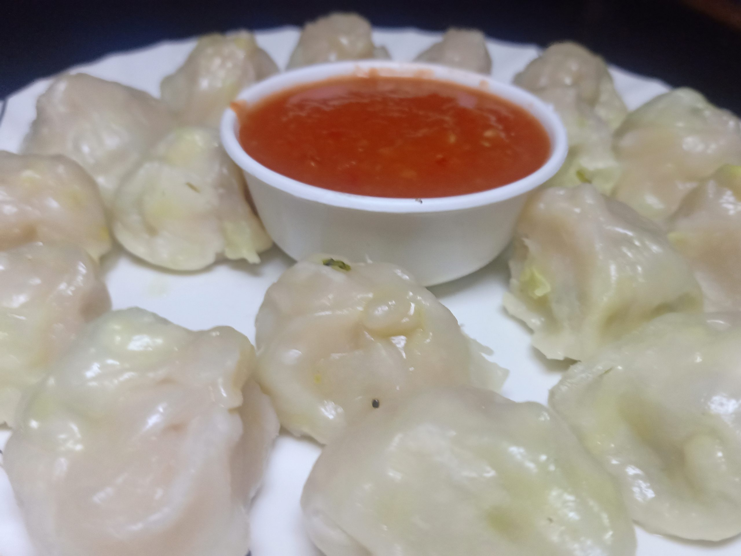 Momos and sauce in the plate