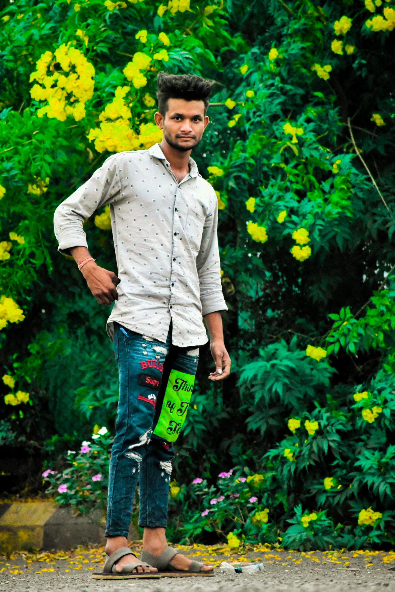 Guy standing in the midst of garden